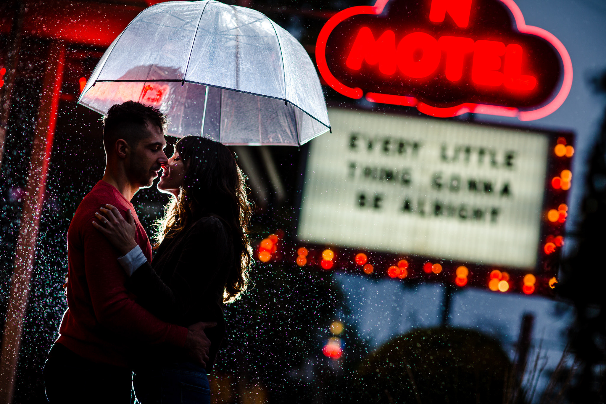 Couple kiss under umbrella - photo by John Winters Photography