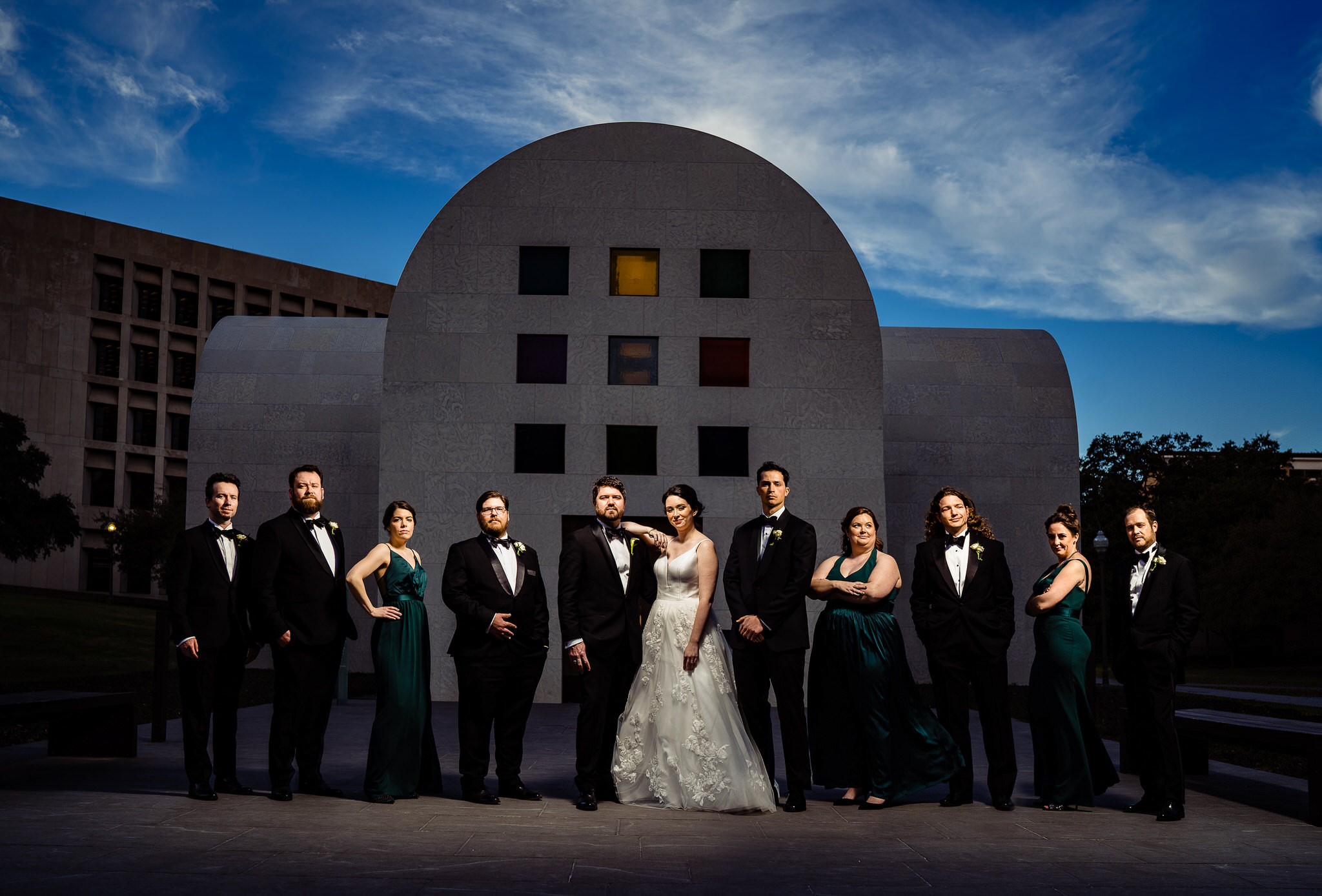 Group shot in front of austere architecture - photo by John Winters Photography