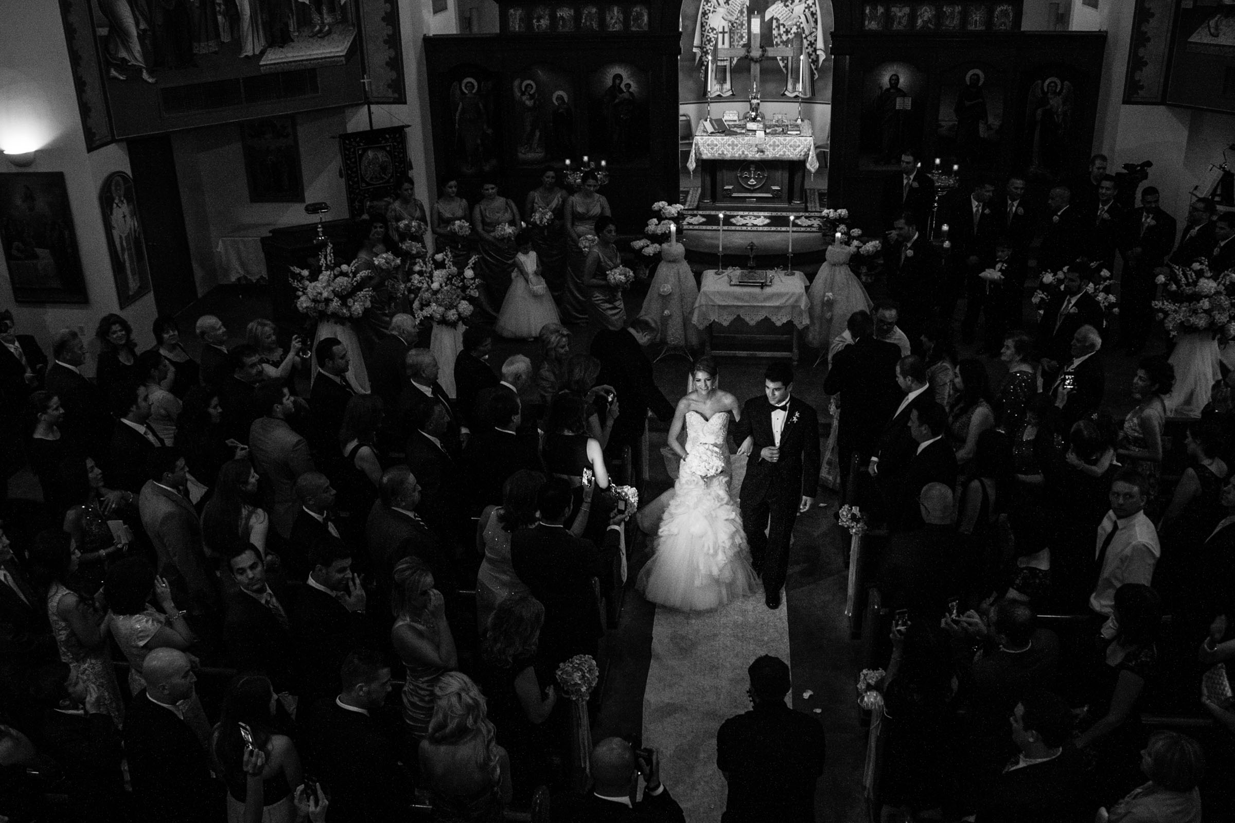 Aerial view of couple recessional in church - photo by MD photo films