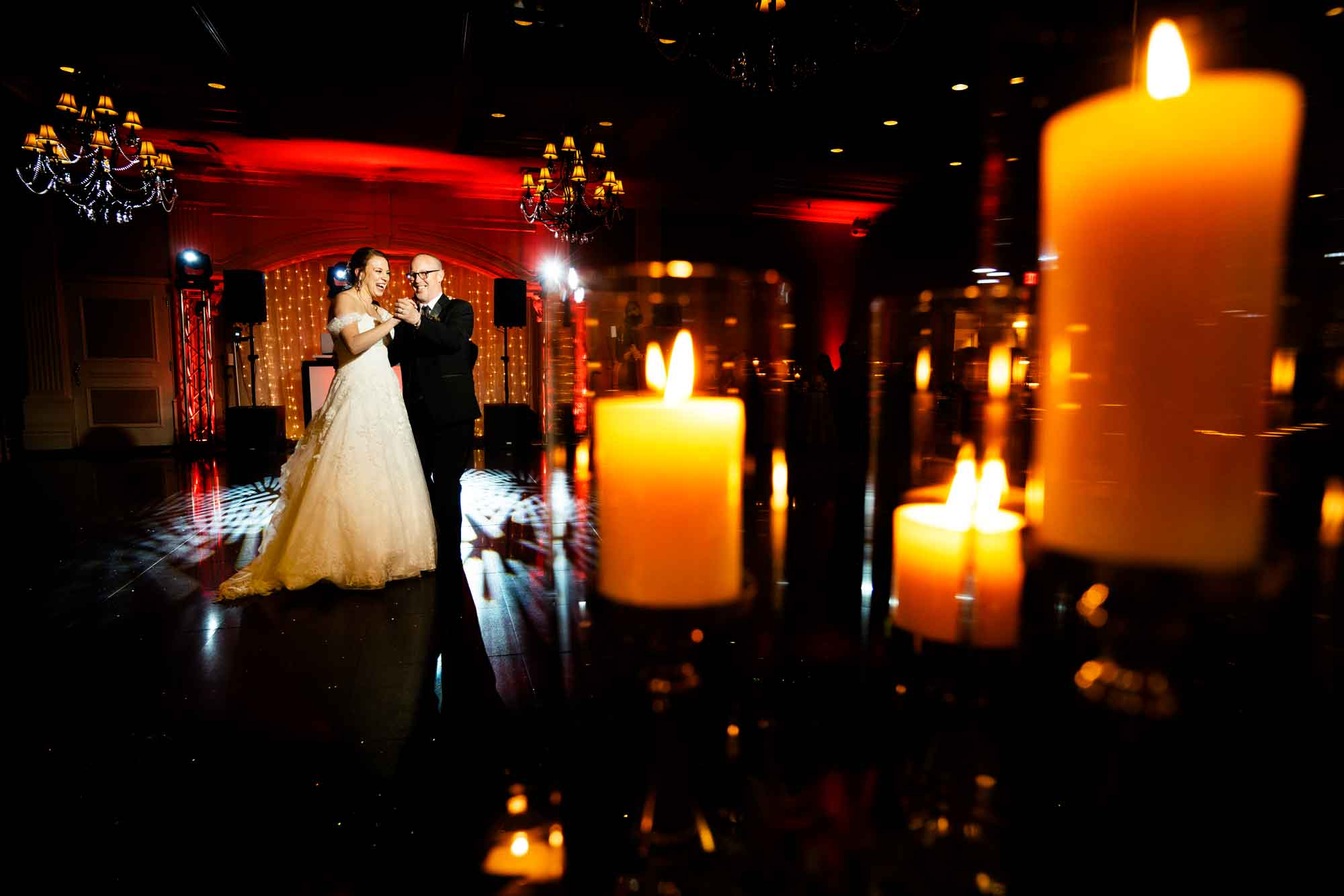 Bride dance with father against profusion of candles - photo by MD photo films