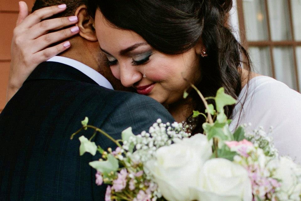 Bride embrace with groom and a rolling tear - photo by MD photo films