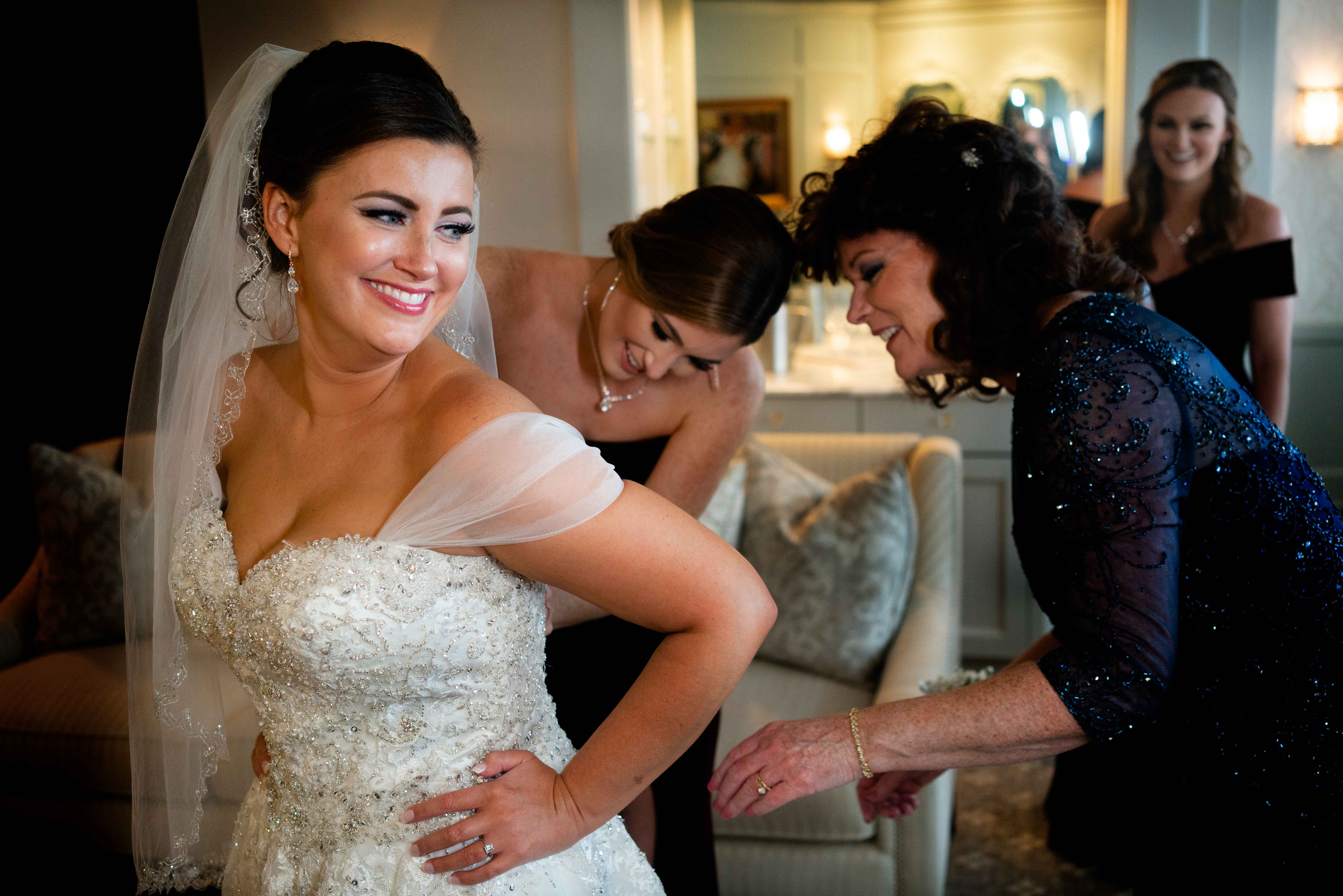 Bride getting ready with a little help from her friends - photo by MD photo films