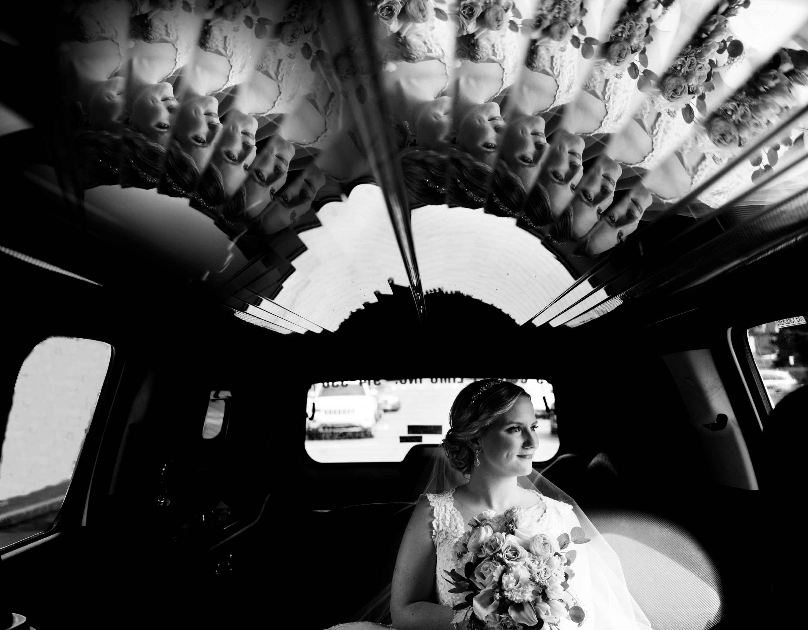 Bride in limo with multiple reflections - photo by MD photo films