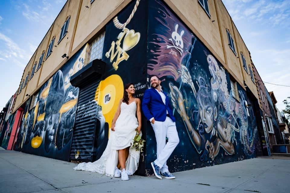 Casual couple pose against graffiti art - photo by MD photo films
