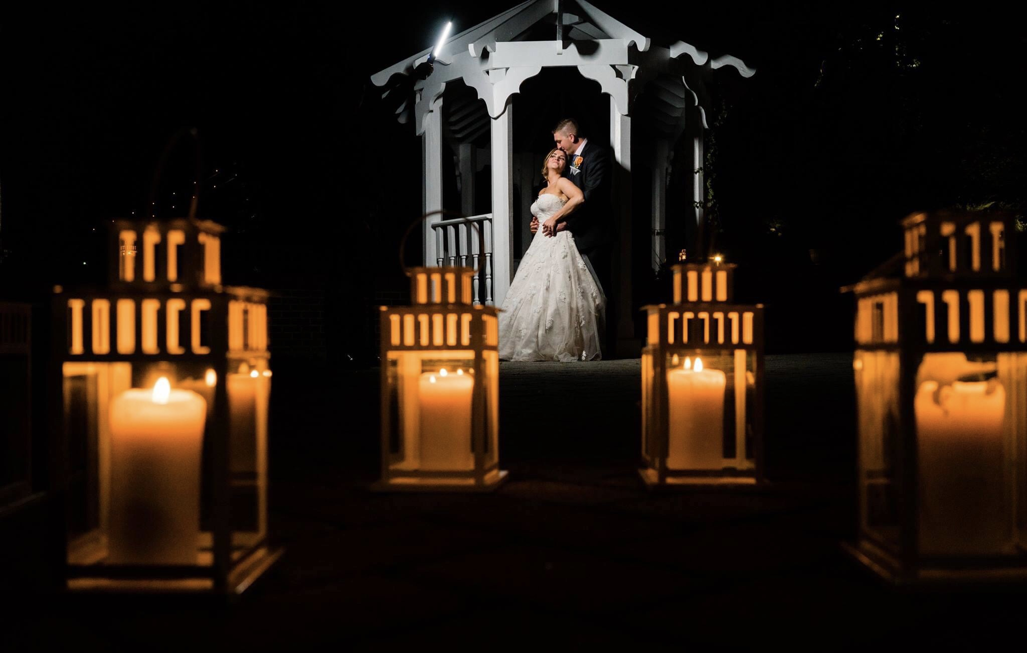 Couple in gazebo with foreground candles - photo by MD photo films