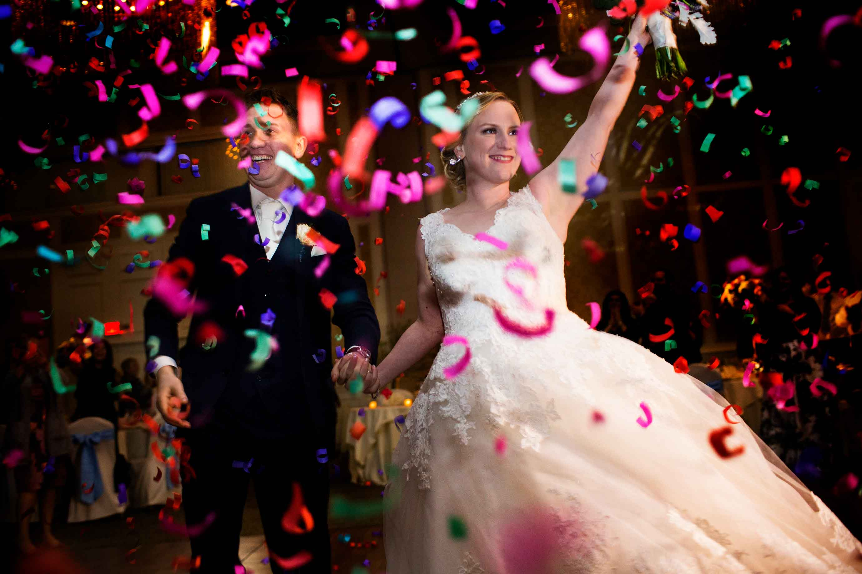 Couple under party confetti - photo by MD photo films