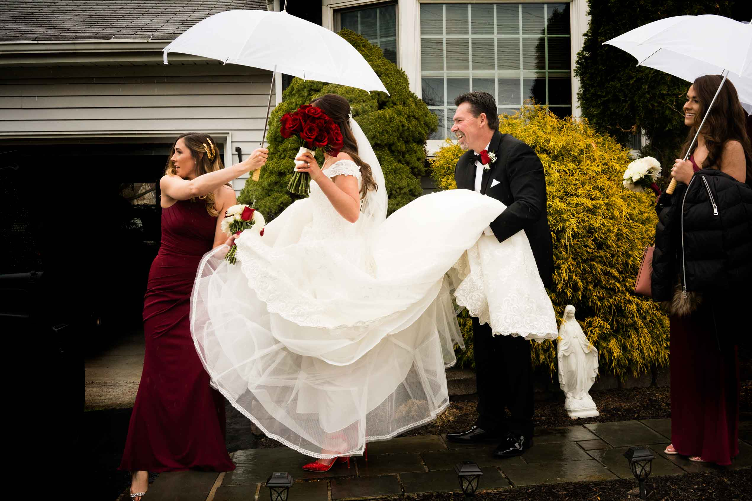 Escorting bride through the rain - photo by MD photo films