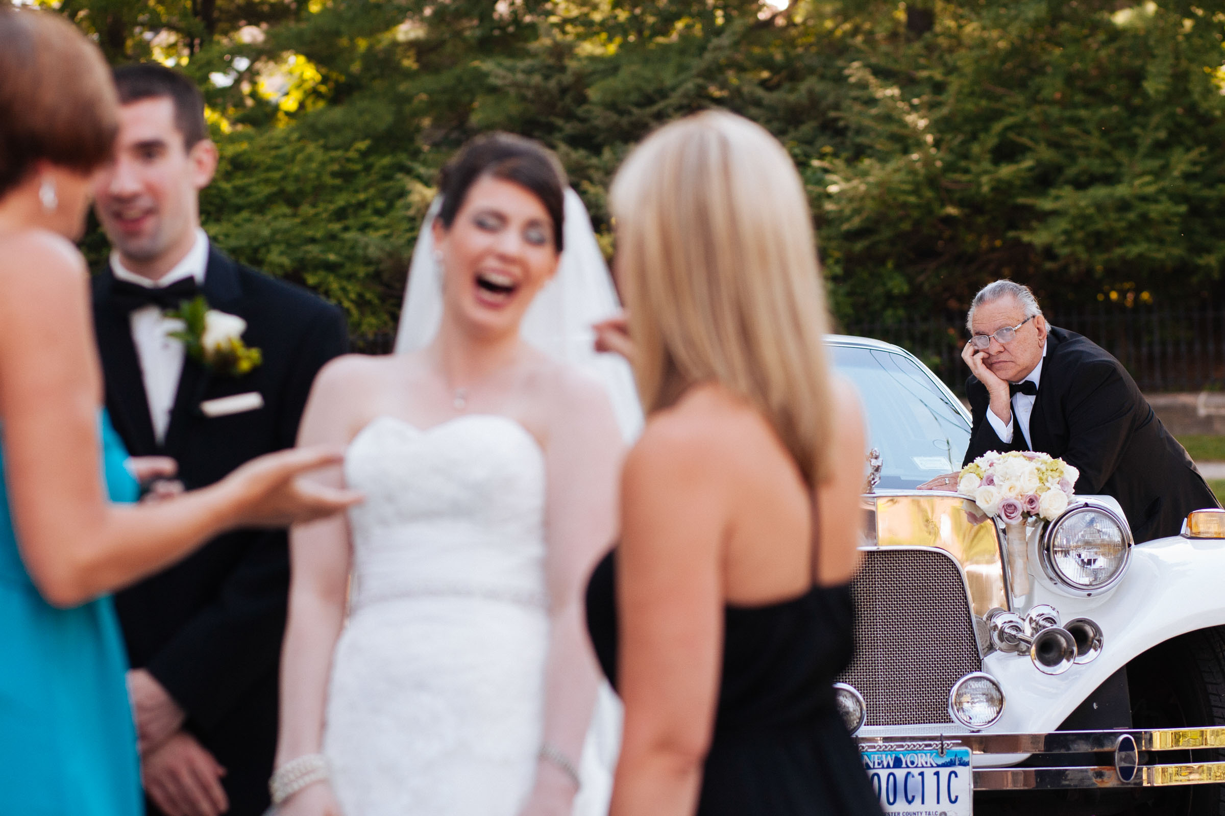 Glum father watches bride and company - photo by MD photo films