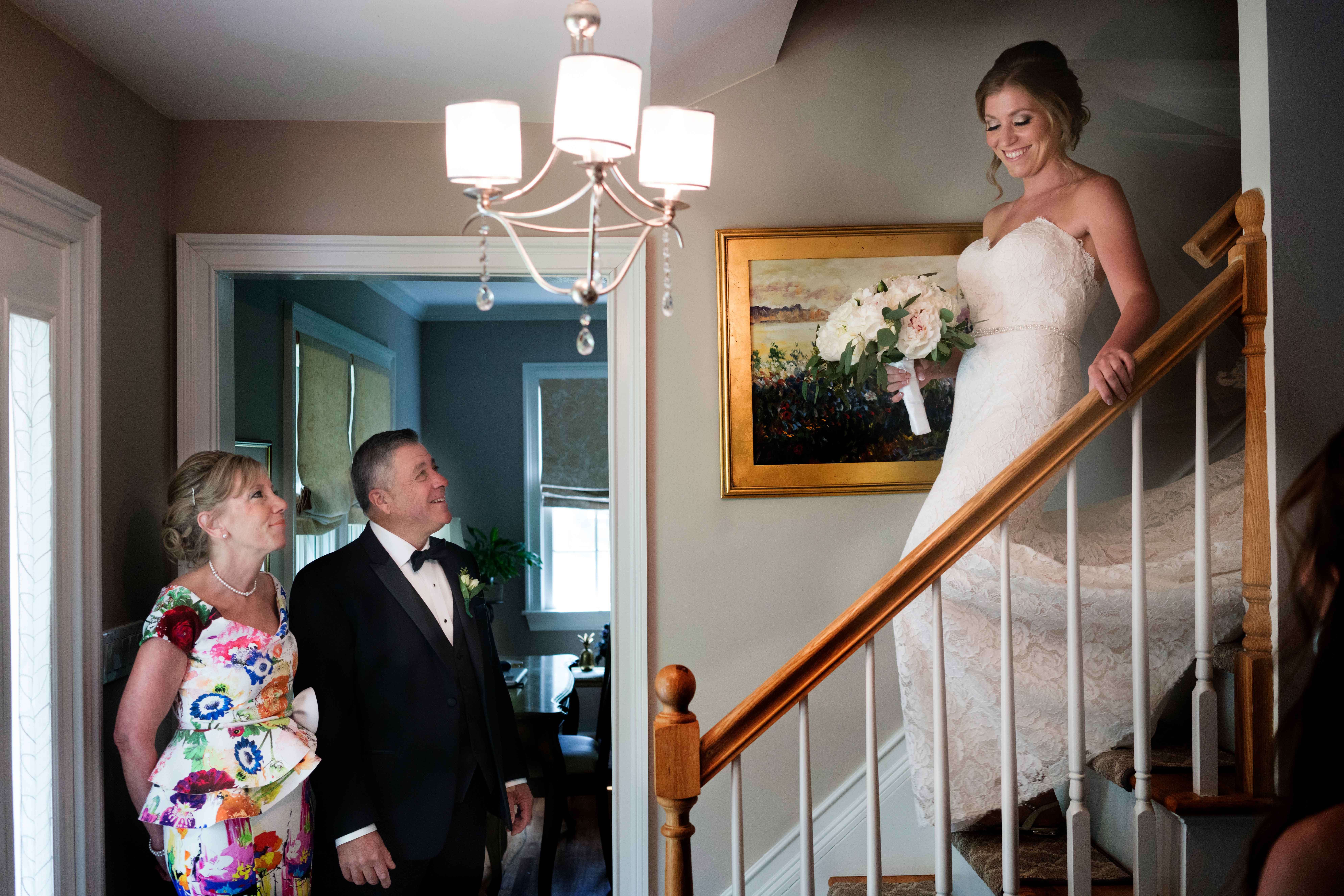 Parents first view of bride descending stairs  - photo by MD photo films