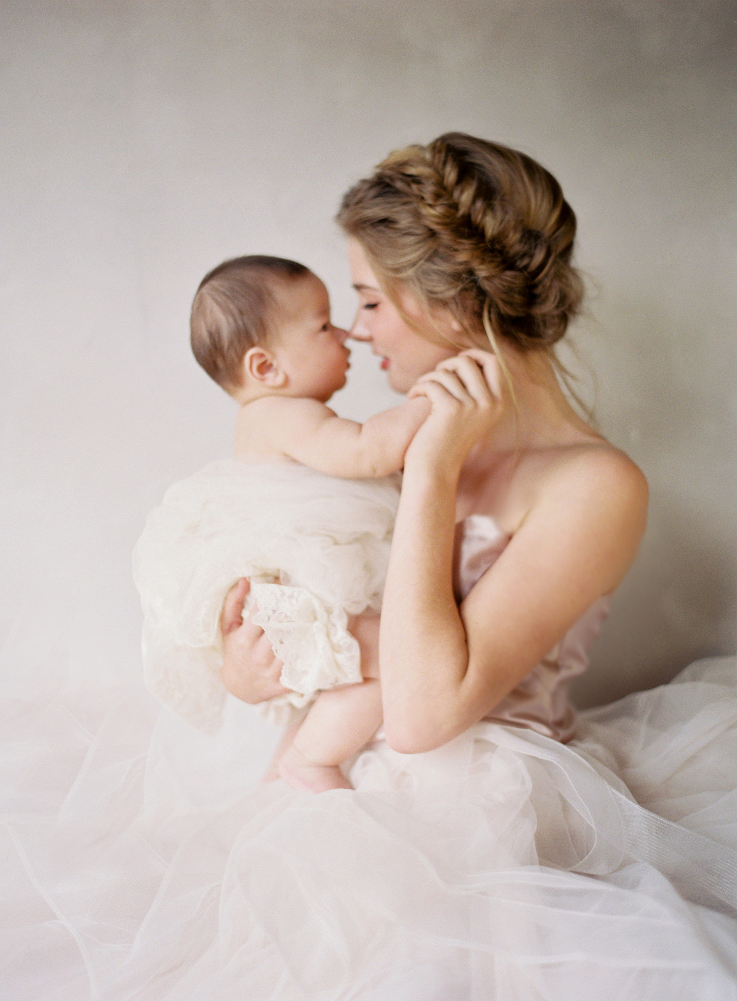 Bride in profile holding baby - photo by Jen Huang