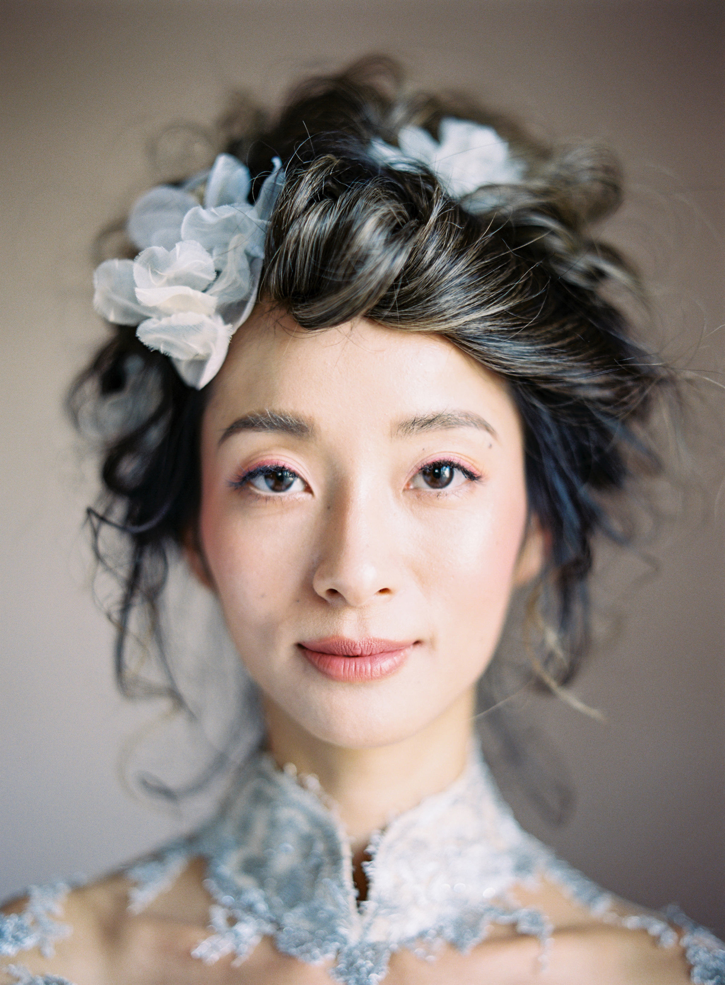Bride with flowers in her hair headshot portrait - photo by Jen Huang