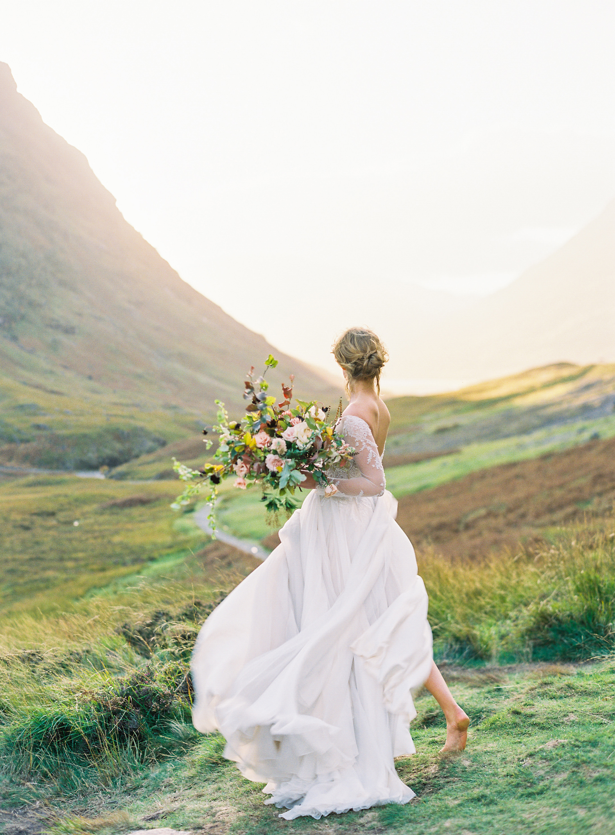 Barefoot bride in Scottish landscape with large colorful bouquet - photo by Jen Huang
