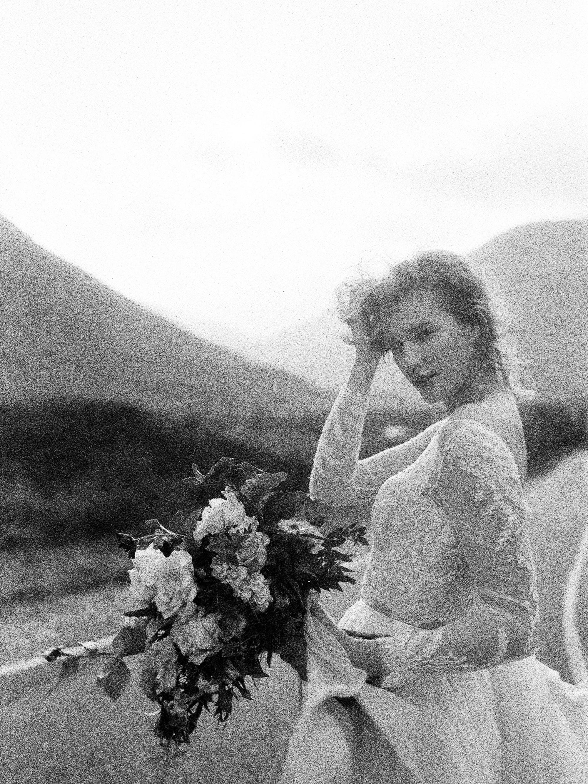 Bride portrait against Scotland landscape - photo by Jen Huang
