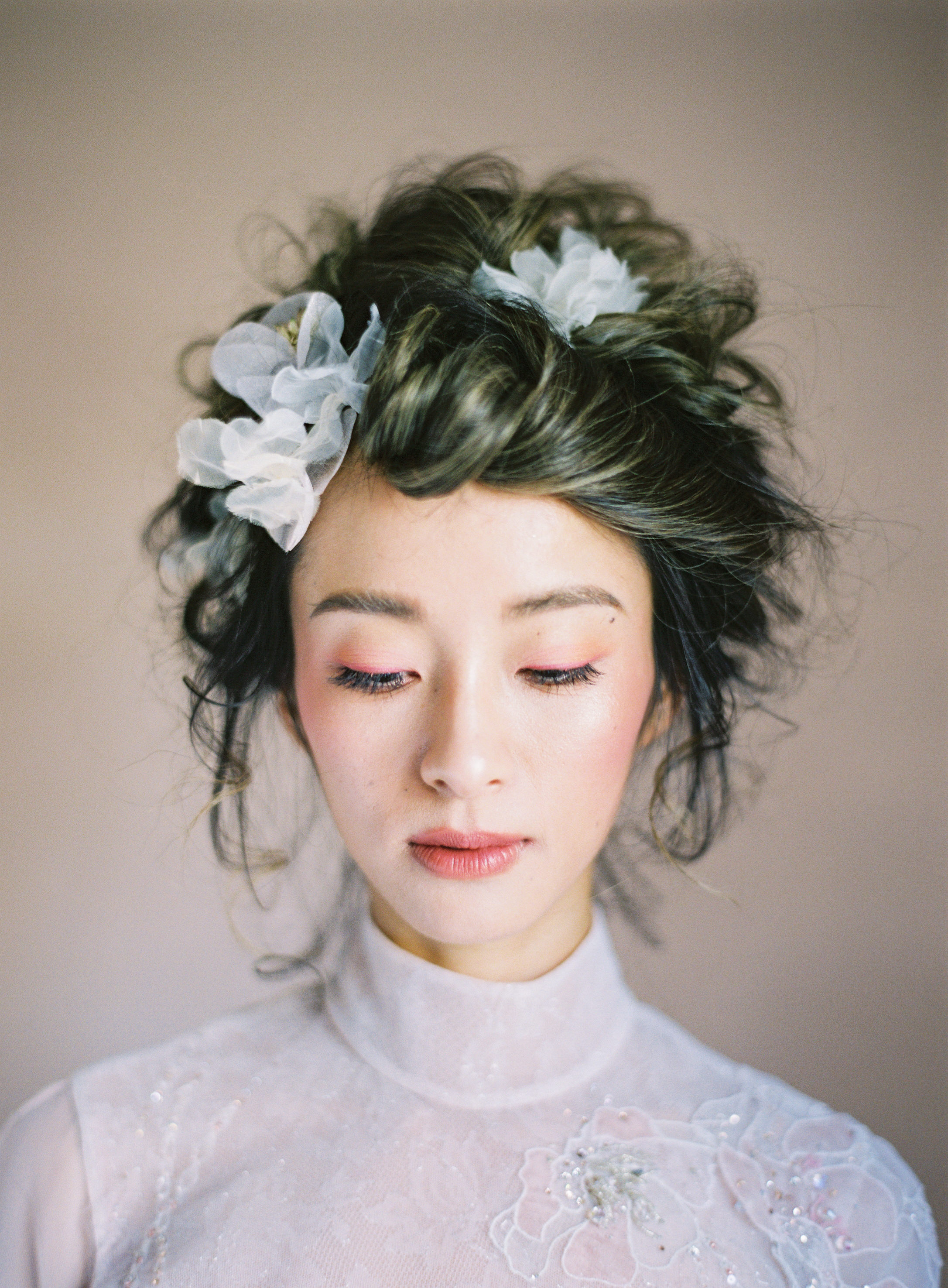 Fashion portrait with floral hair accessories - photo by Jen Huang