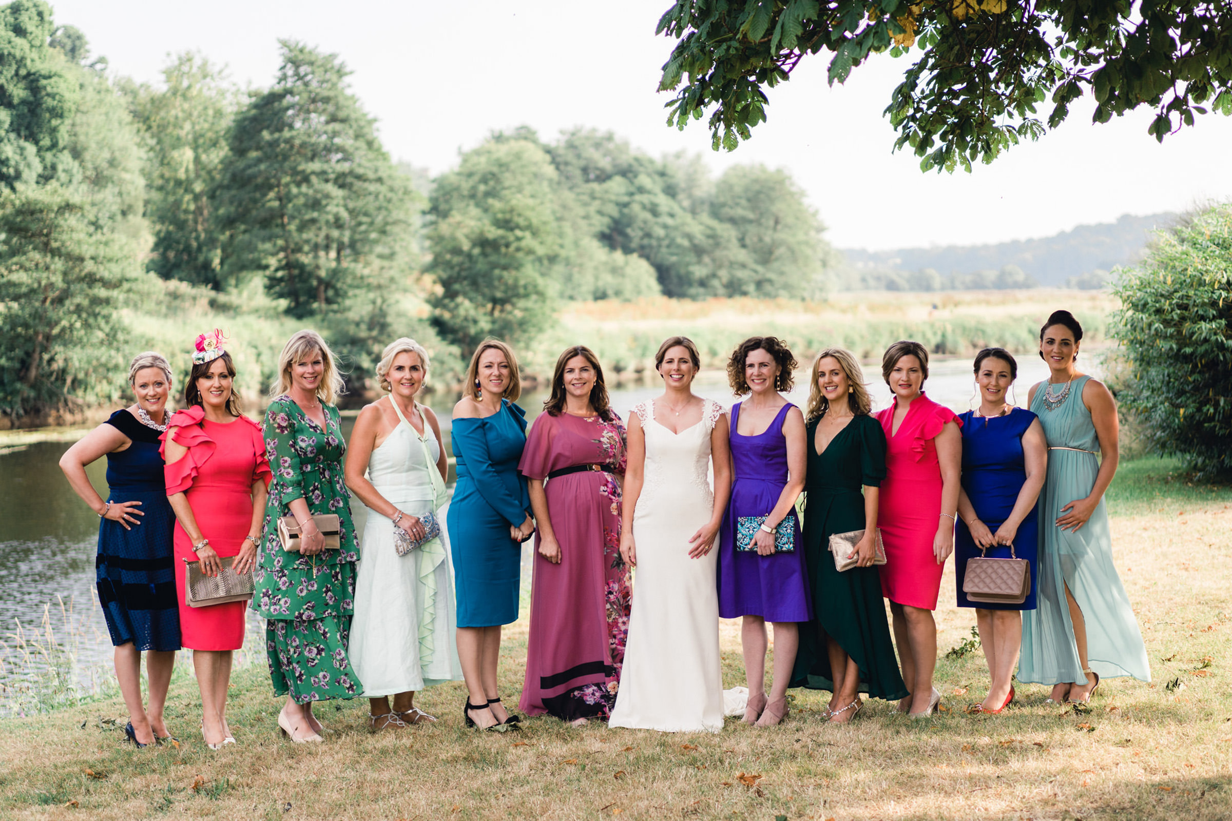 Bride group shot with female guests - photo by The Portrait Rooms