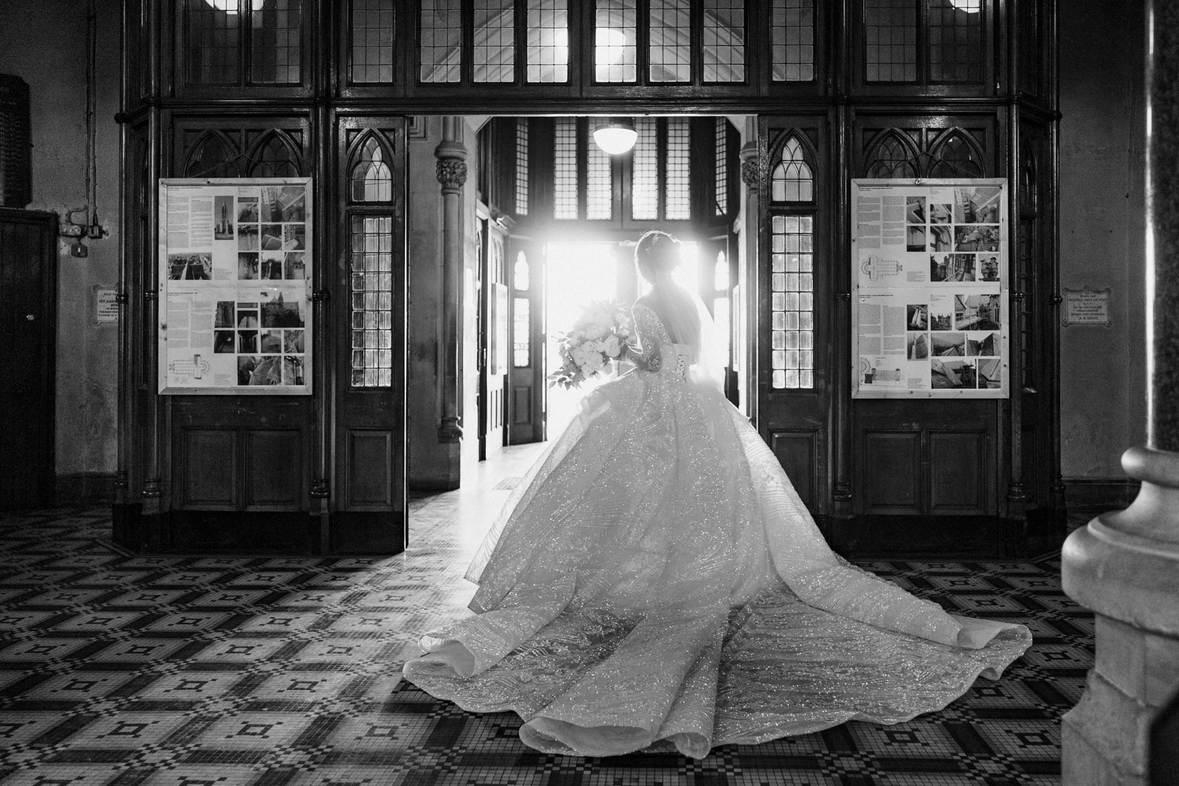 Bride in extravagant gown - photo by The Portrait Rooms