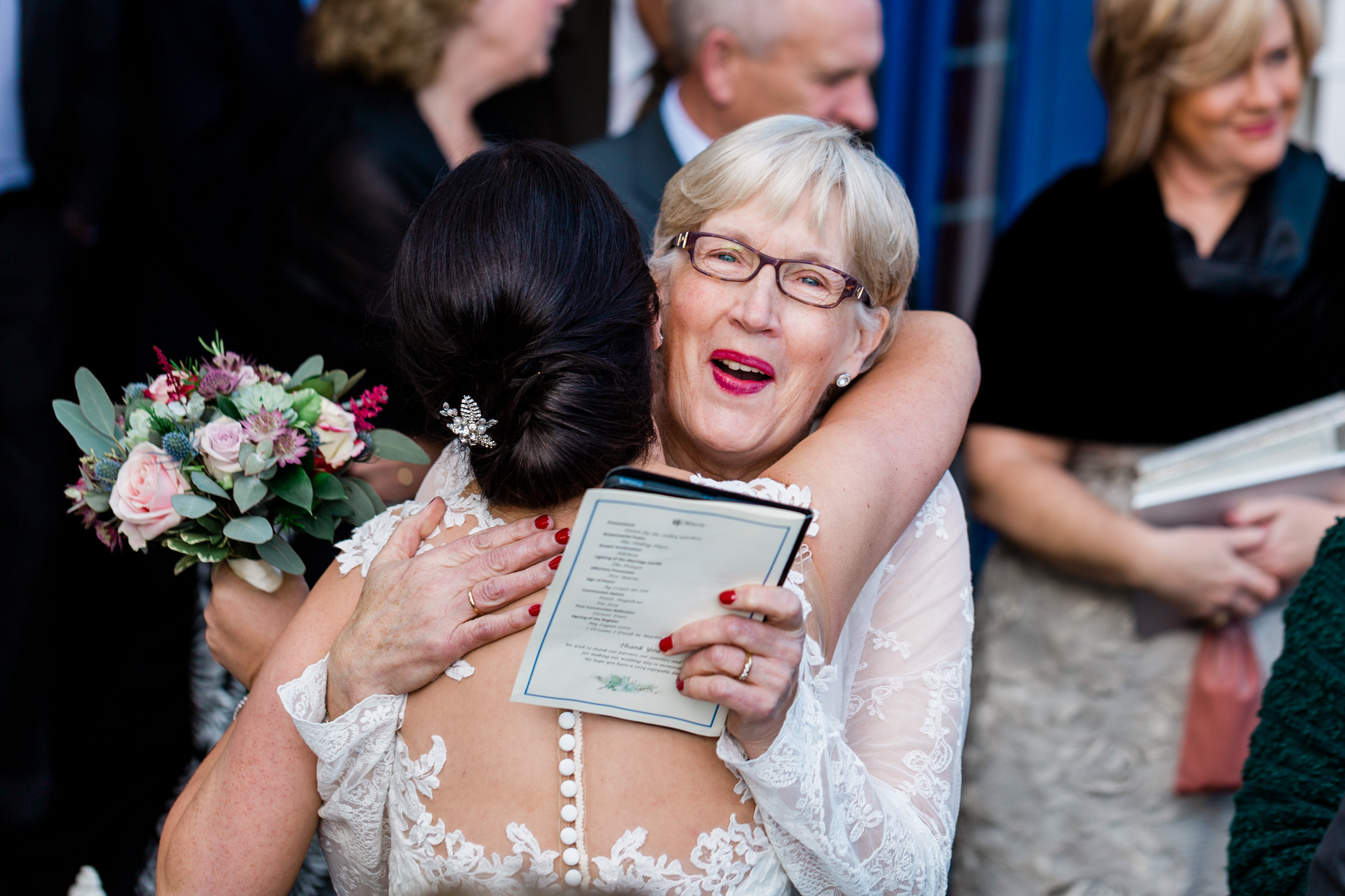 Bride mother embrace - photo by The Portrait Rooms