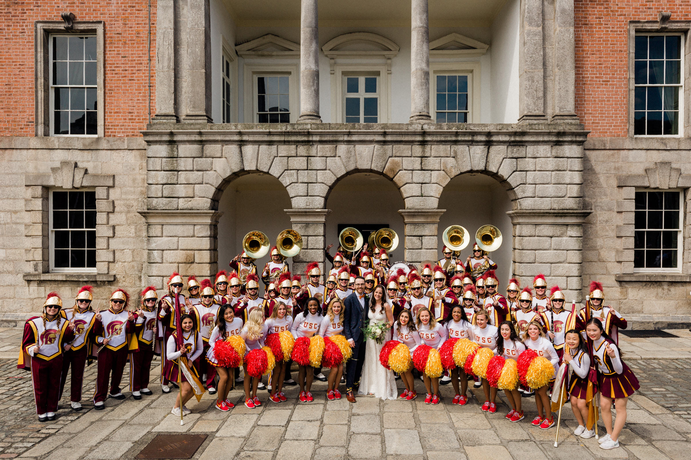 Couple with brass band and USC cheerleaders - photo by The Portrait Rooms