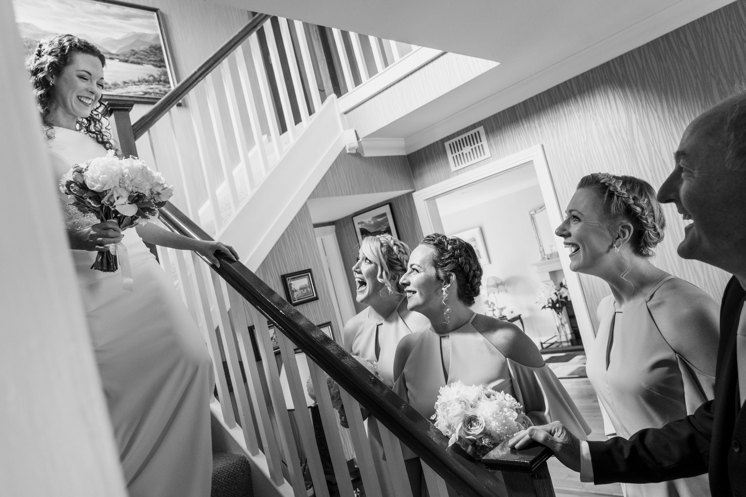 First look at bride descending staircase - photo by The Portrait Rooms