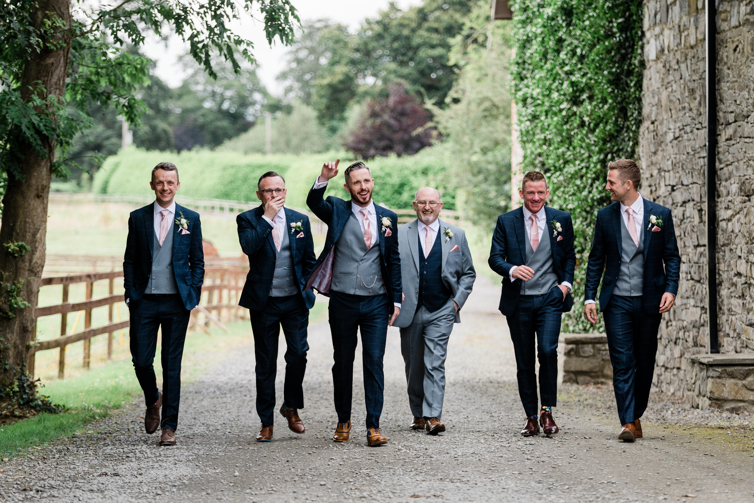 Groomsmen and father on country road Ireland - photo by The Portrait Rooms