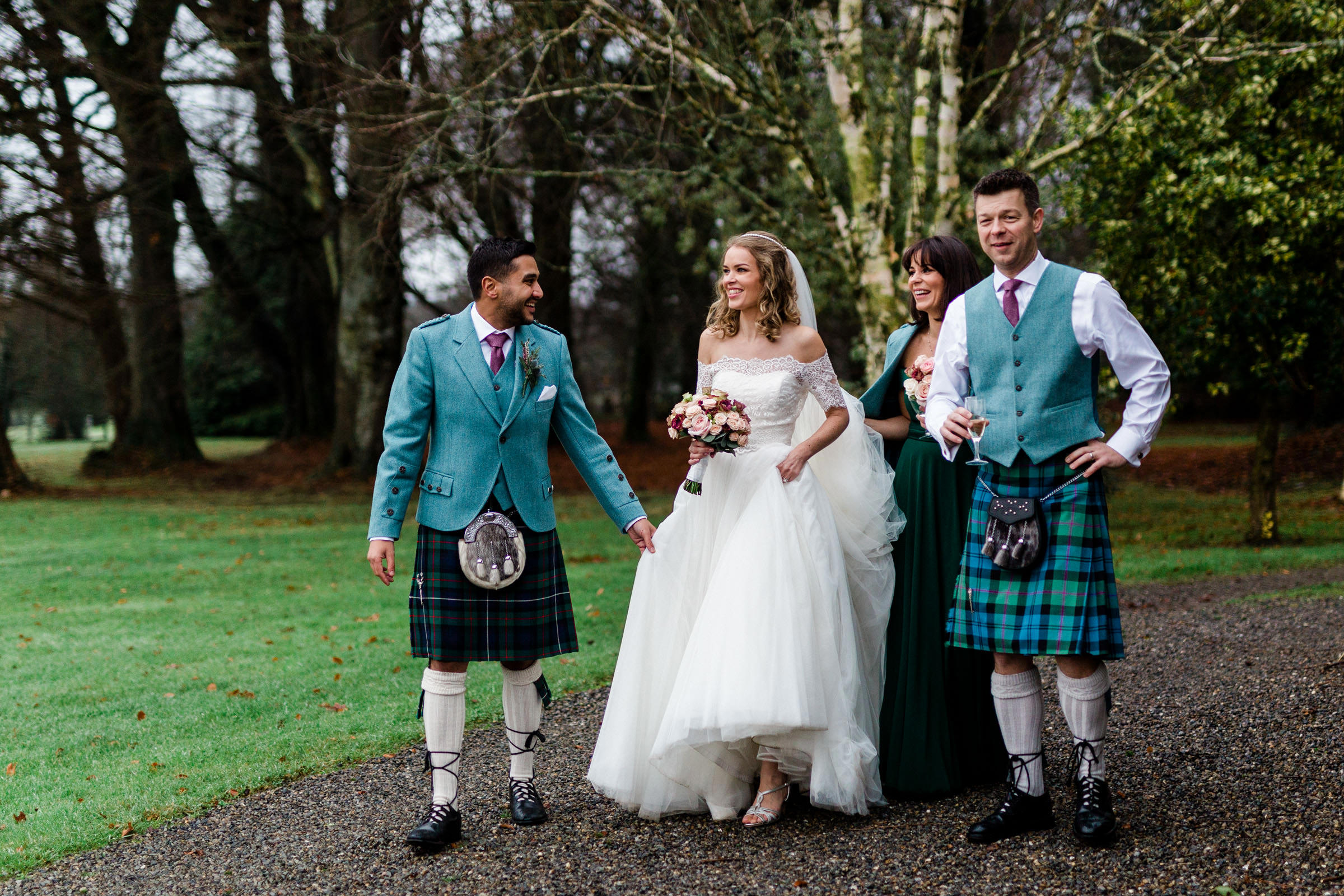 Groomsmen in kilts with bride - photo by The Portrait Rooms