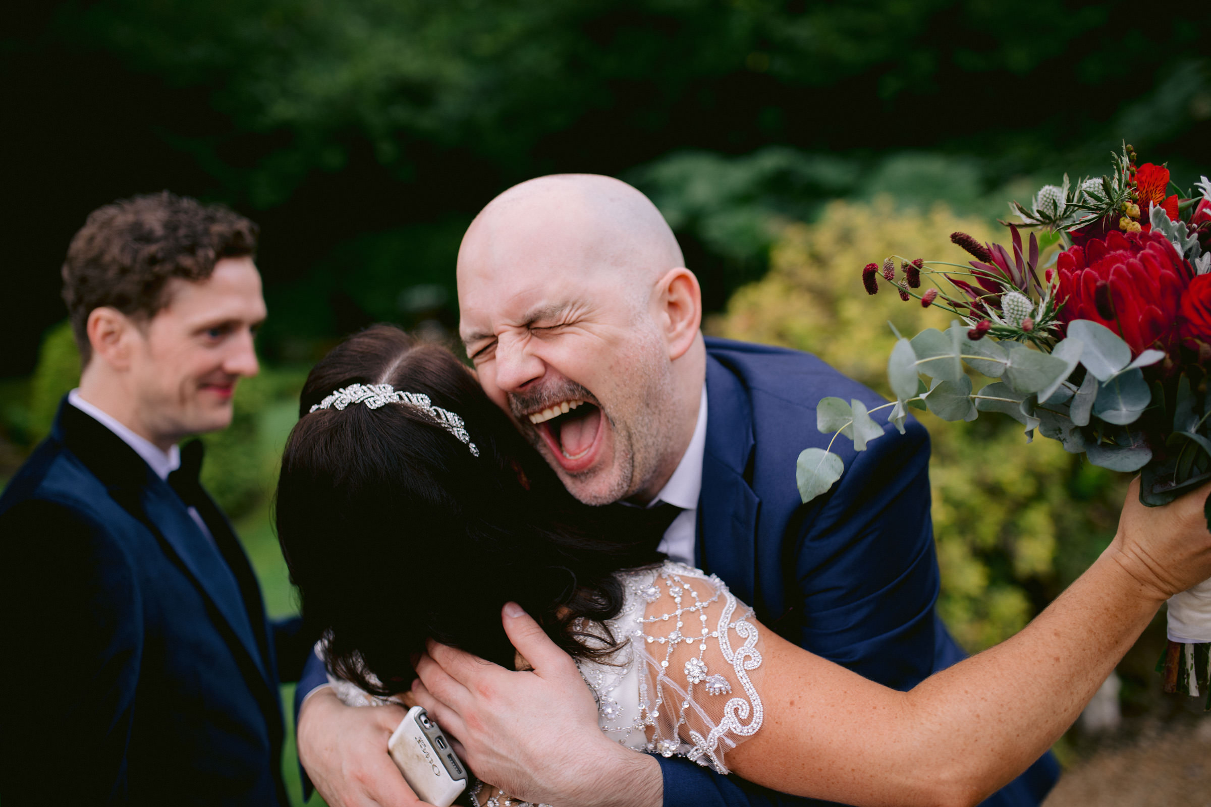 Huge hug for the bride - photo by The Portrait Rooms