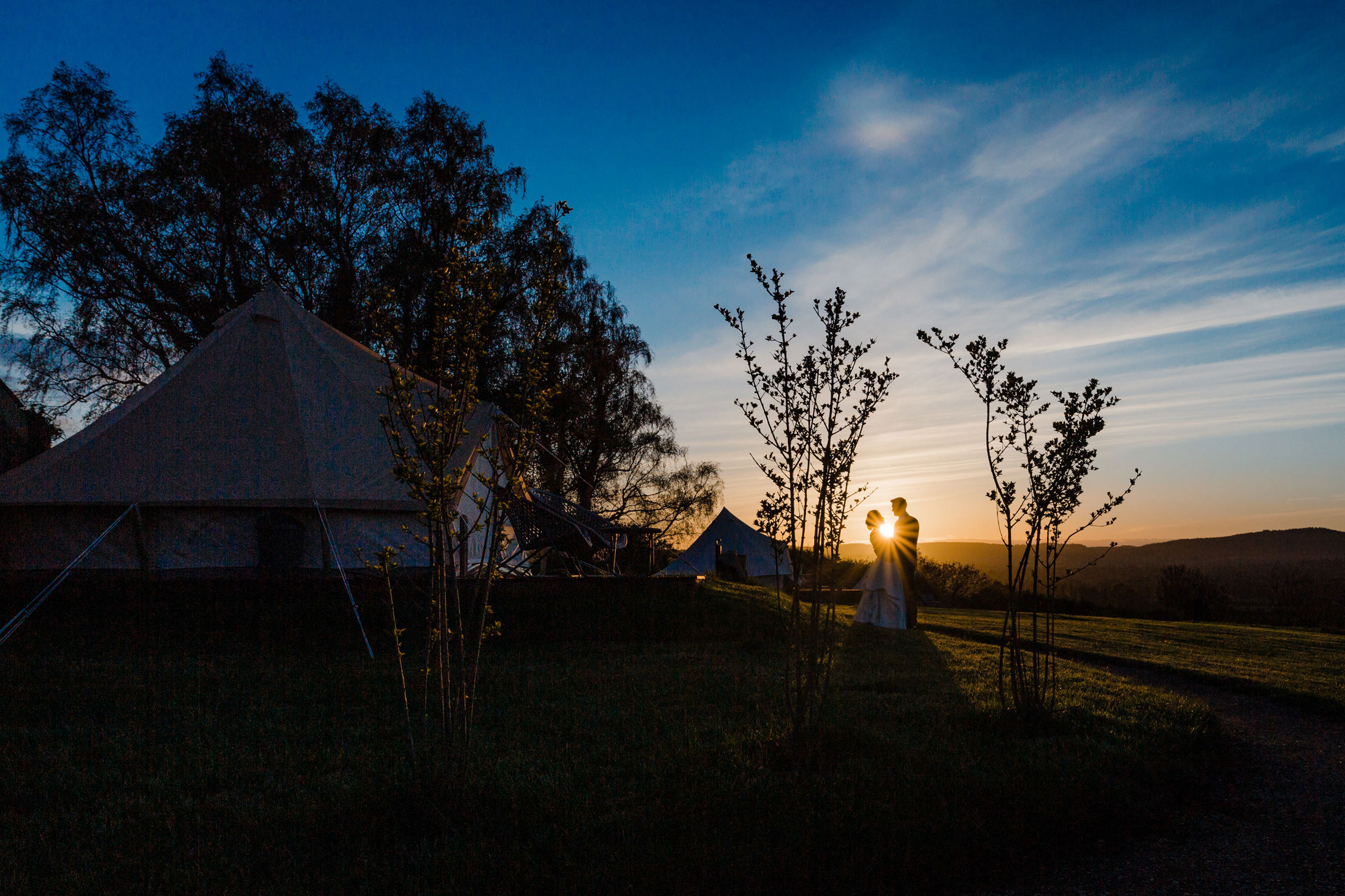 Sunset couple silhouette in rustic setting Ireland - photo by The Portrait Rooms