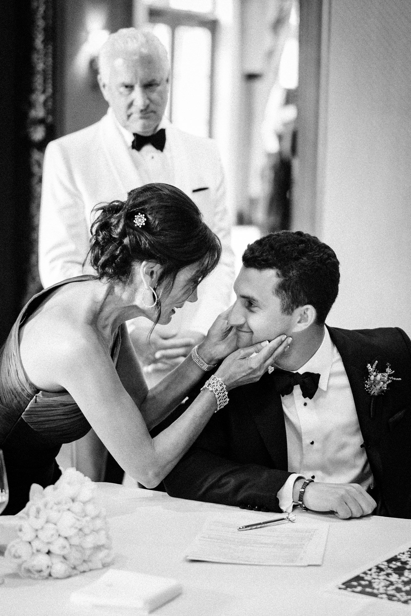 sweet moment between bride and groom - photo by john and joseph photography