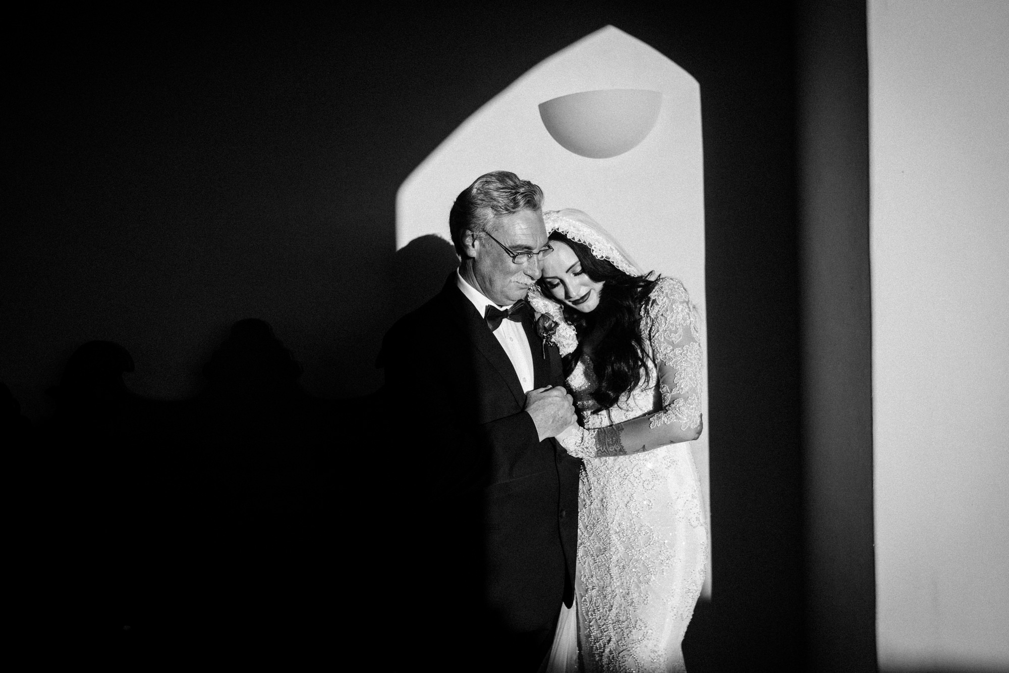 Bride and father embrace - photo by John & Joseph