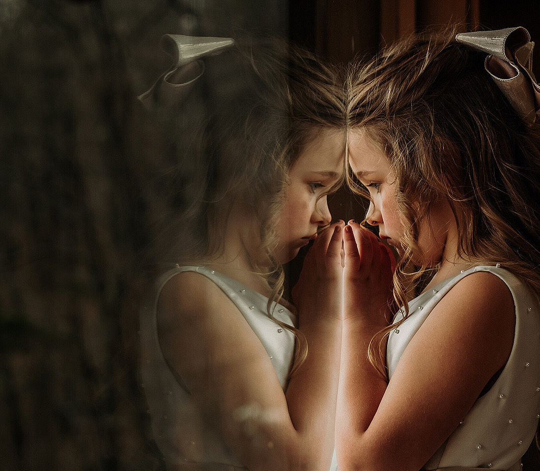 Girl reflects in mirror- photo by Miles Witt Boyer Photographic Collective
