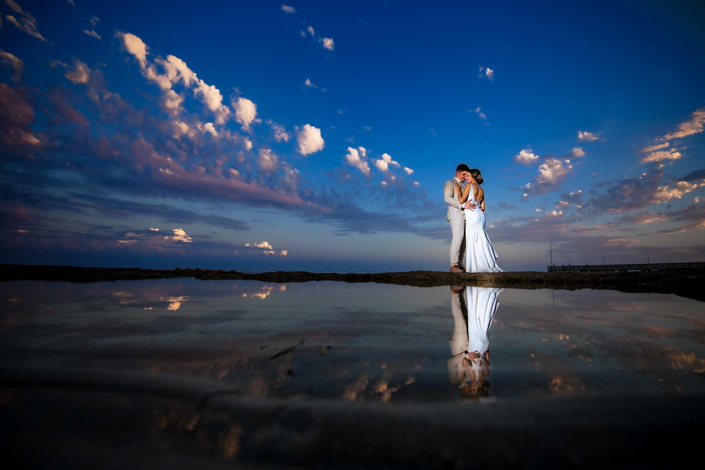 Couple against big sky reflected - photo by Michael Freas Photography