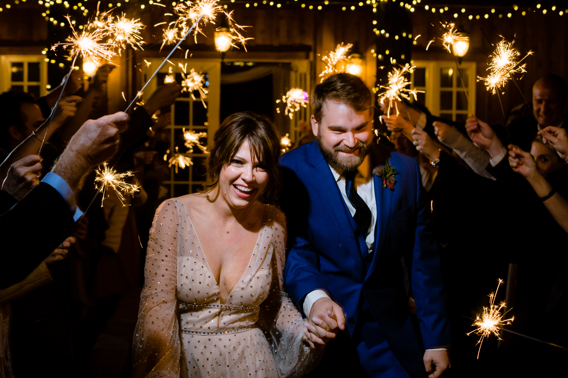 Couple exit under sparklers - photo by Michael Freas Photography
