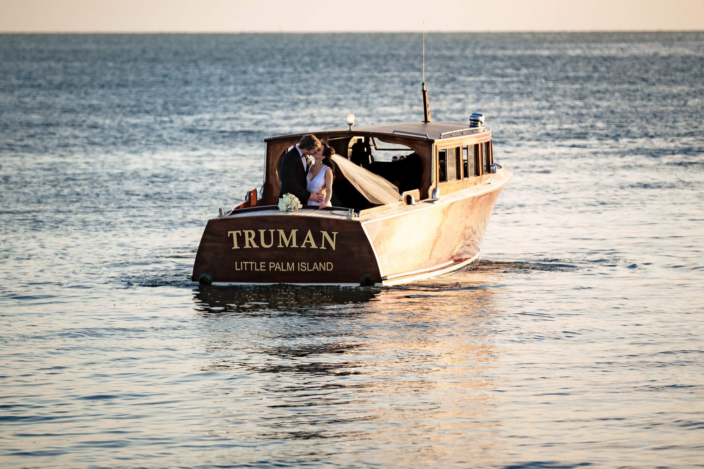 Couple on stern of small boat - photo by Michael Freas Photography