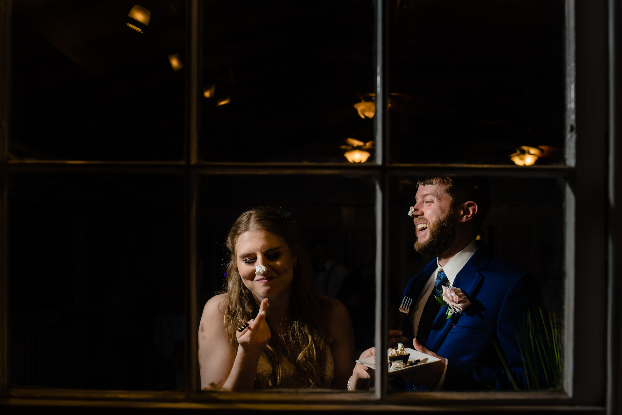 Bride and groom with cake on their noses  - photo by Michael Freas Photography - Connecticut