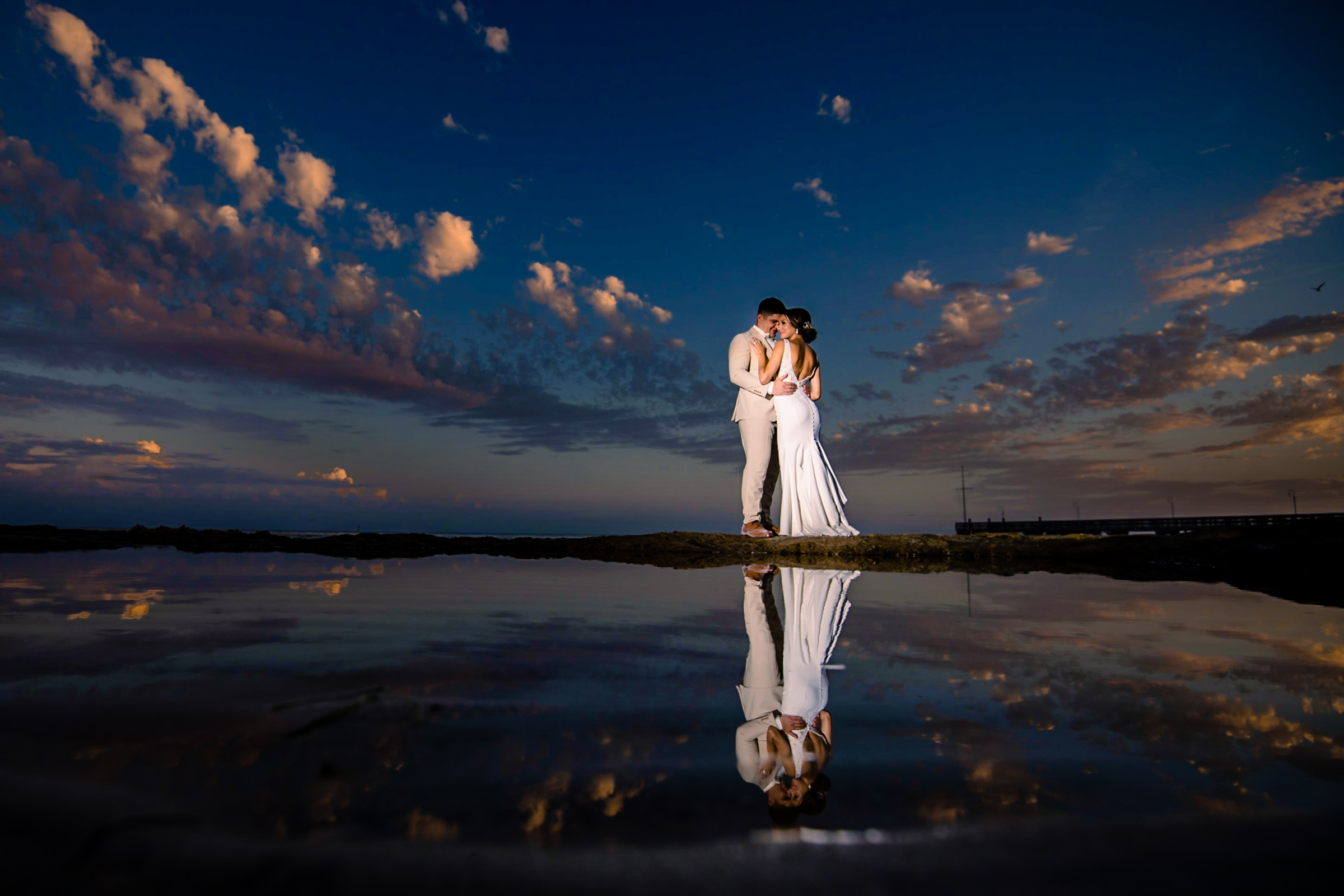 Couple reflected in water against dusky sky - photo by Michael Freas Photography - North Carolina