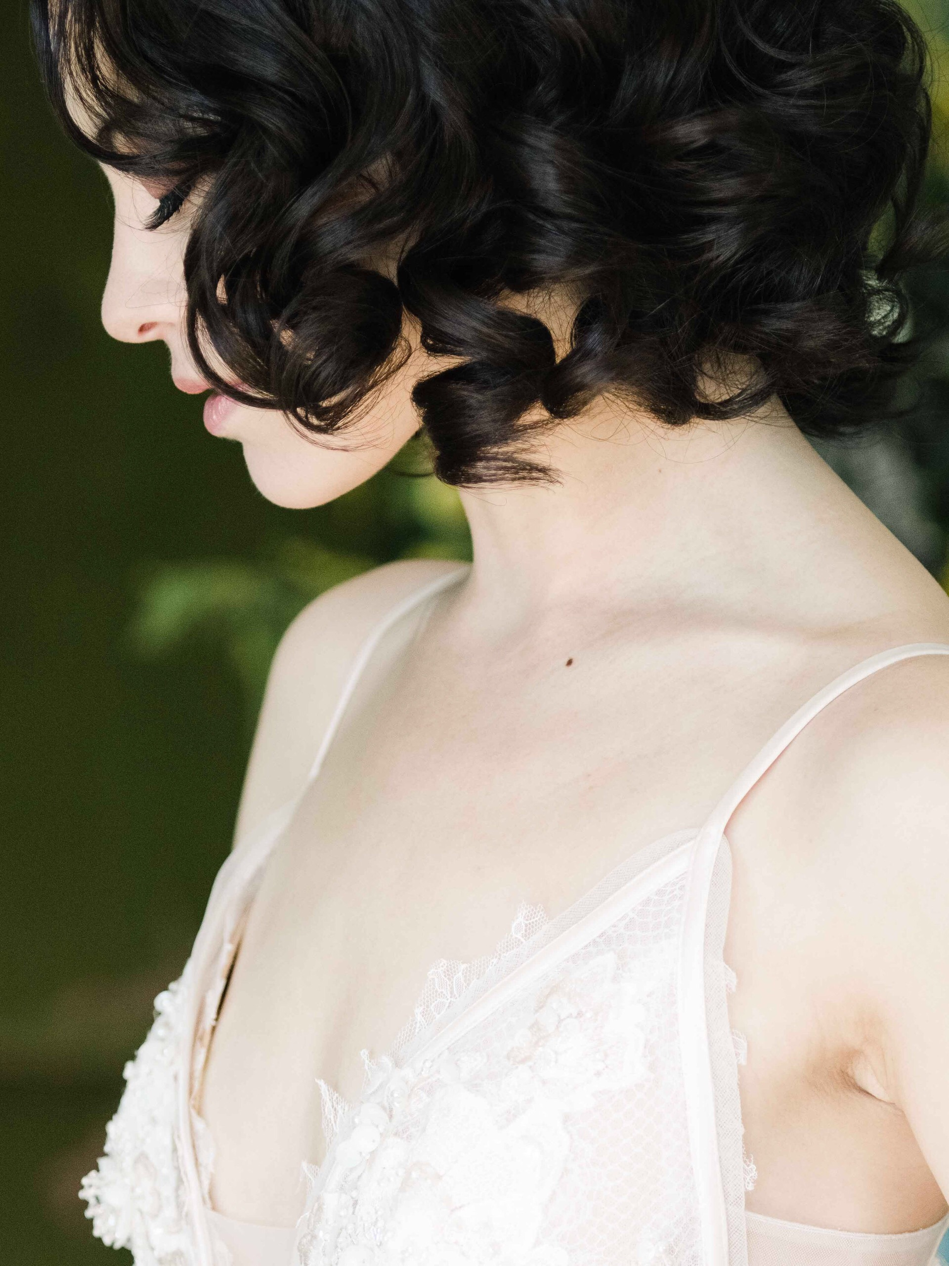 Romantic profile of bride with curly black hair- photo by All the Little Stories Photography - MA