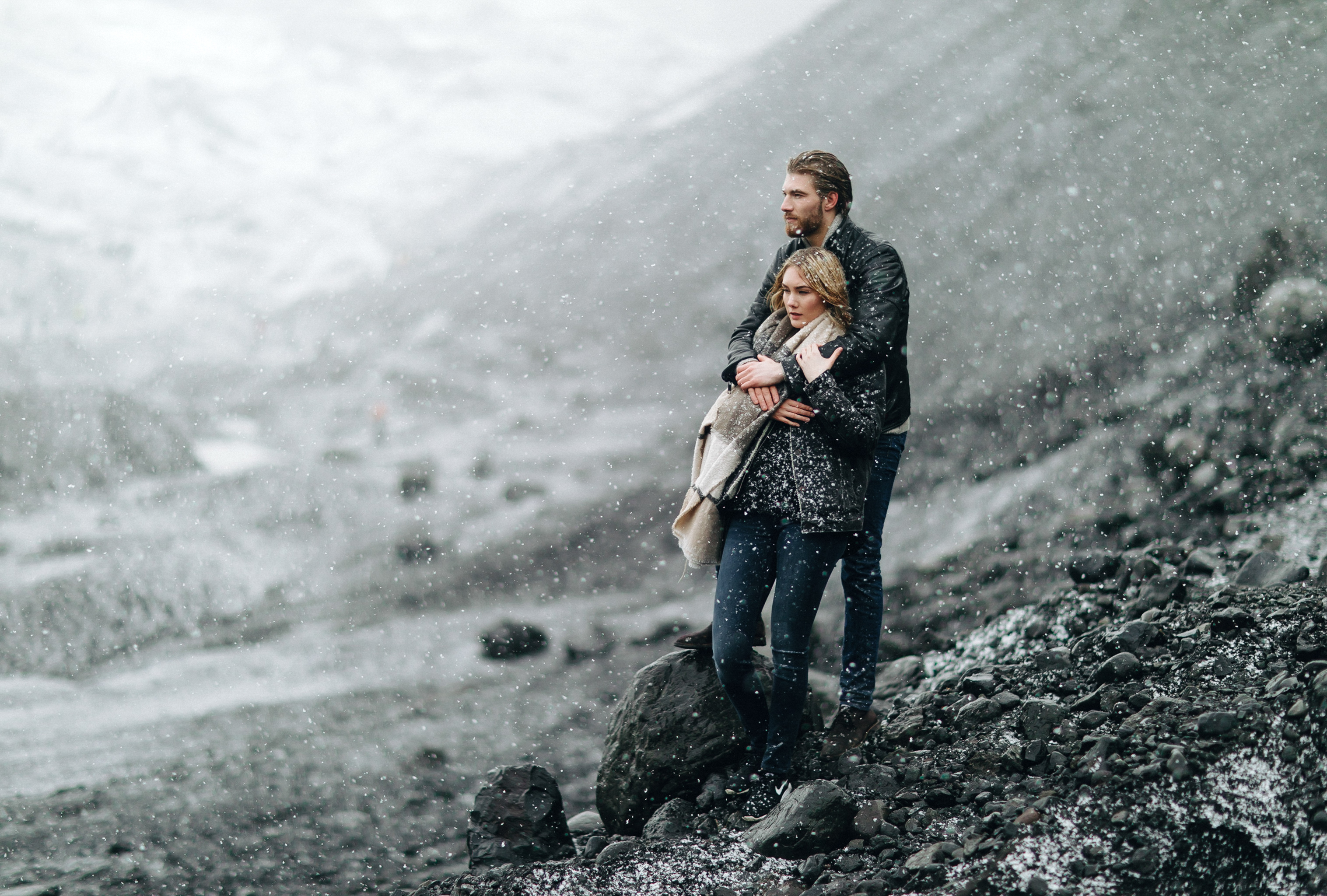 Couple in winter and snow against mountains - photo by Daniel Colvin Photography