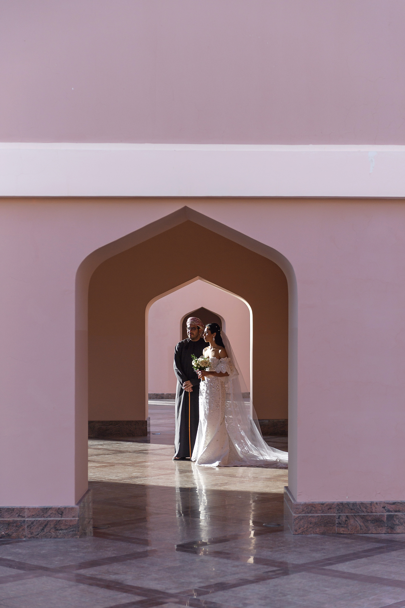 bride and groom seen through archway - photo by 37 Frames