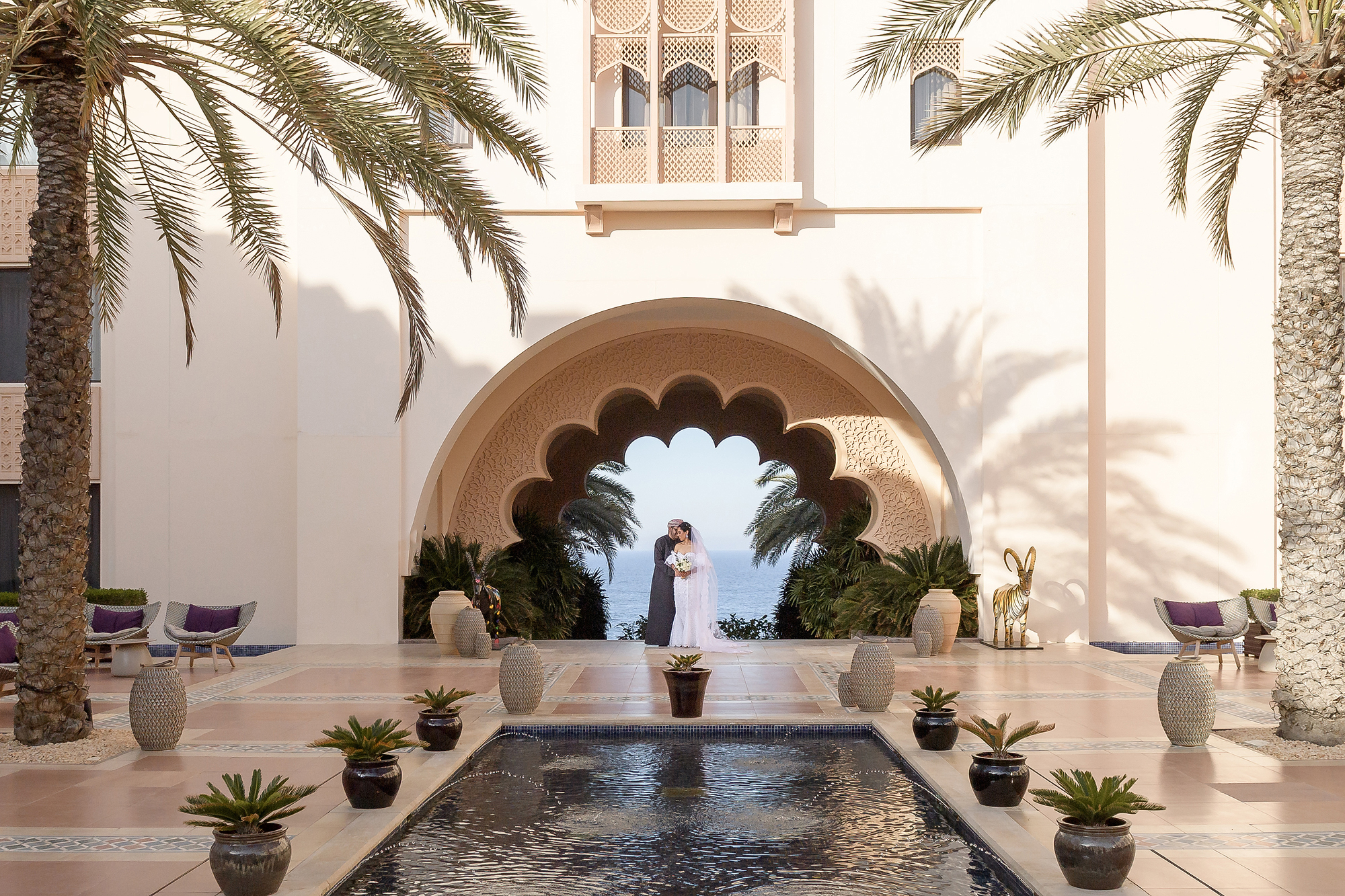 Couple against courtyard reflection pool - photo by 37 Frames