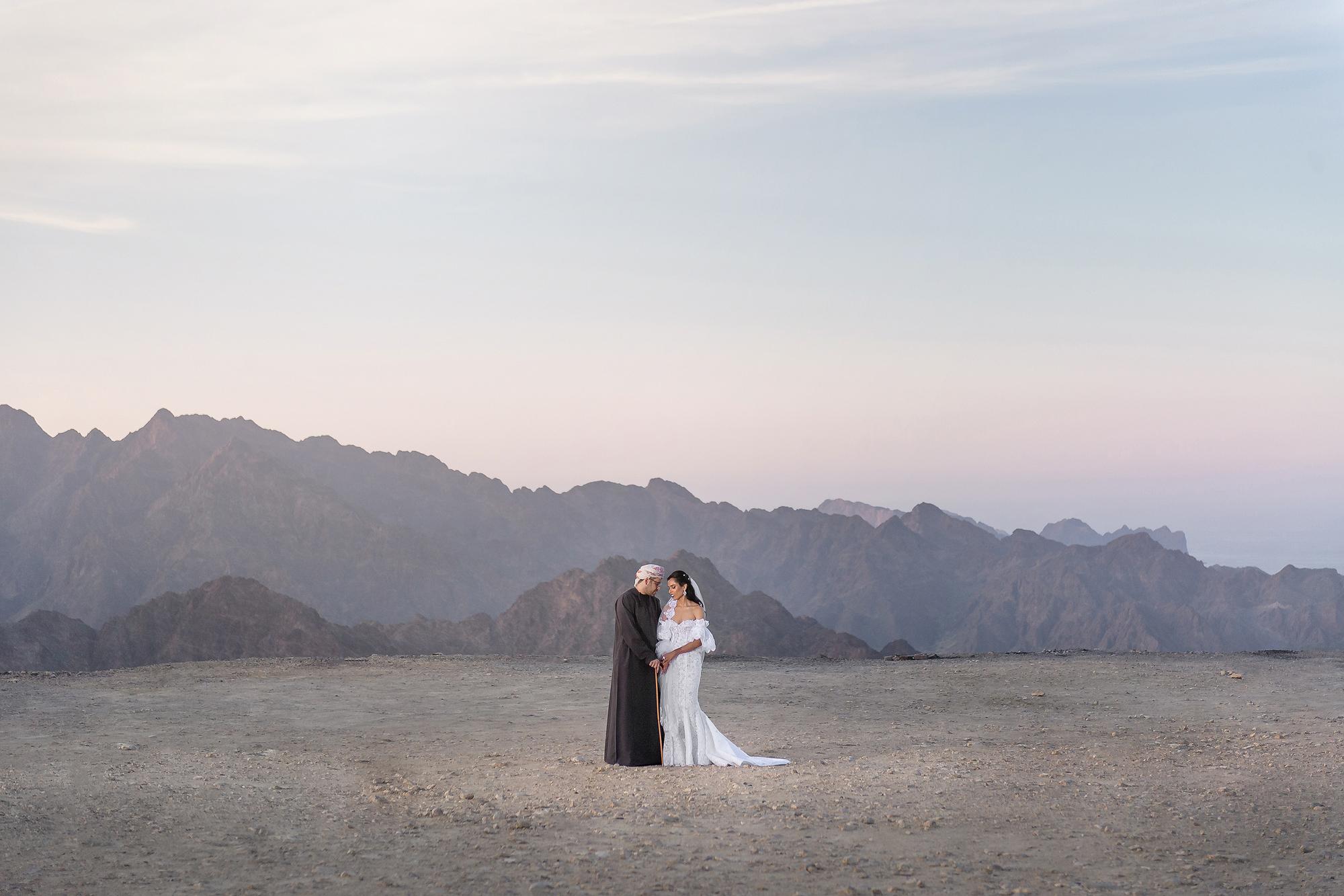 Couple landscape portrait against mountains - photo by 37 Frames