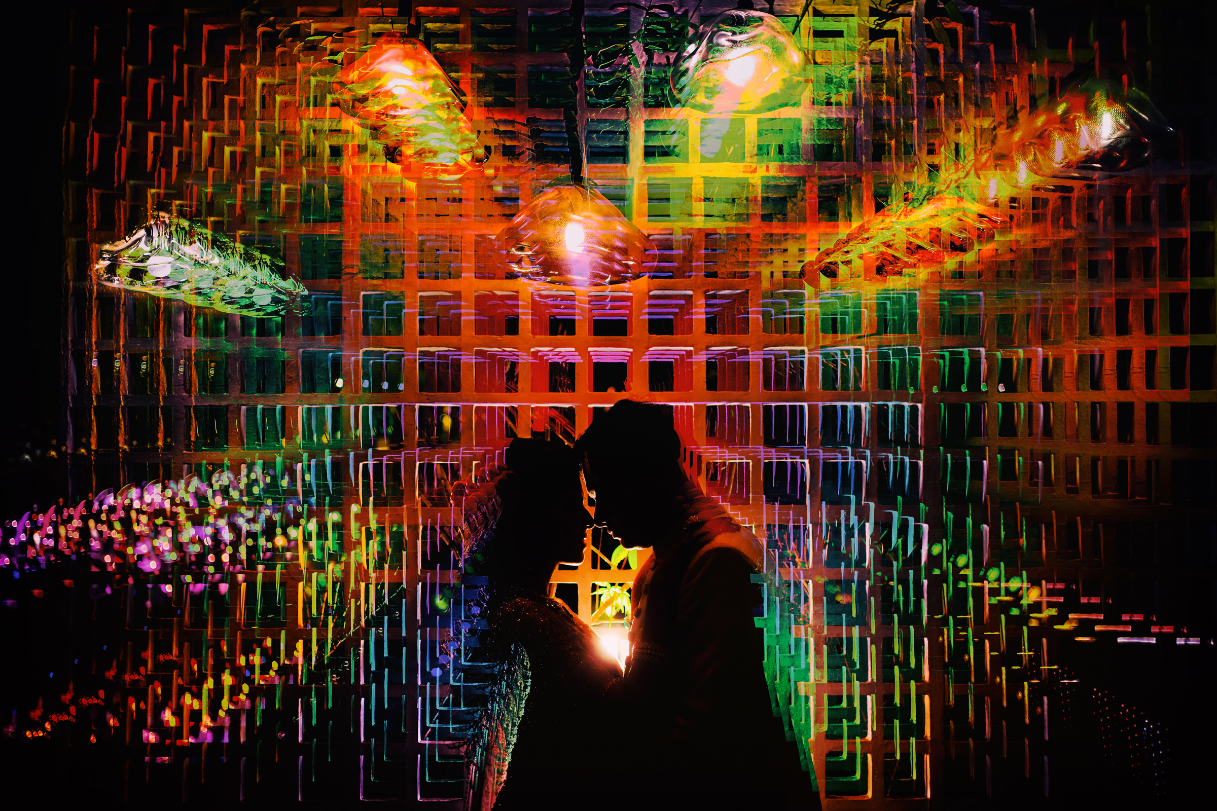 Colorful creative silhouette against geometric lights - photo by Tej Nookala Photography