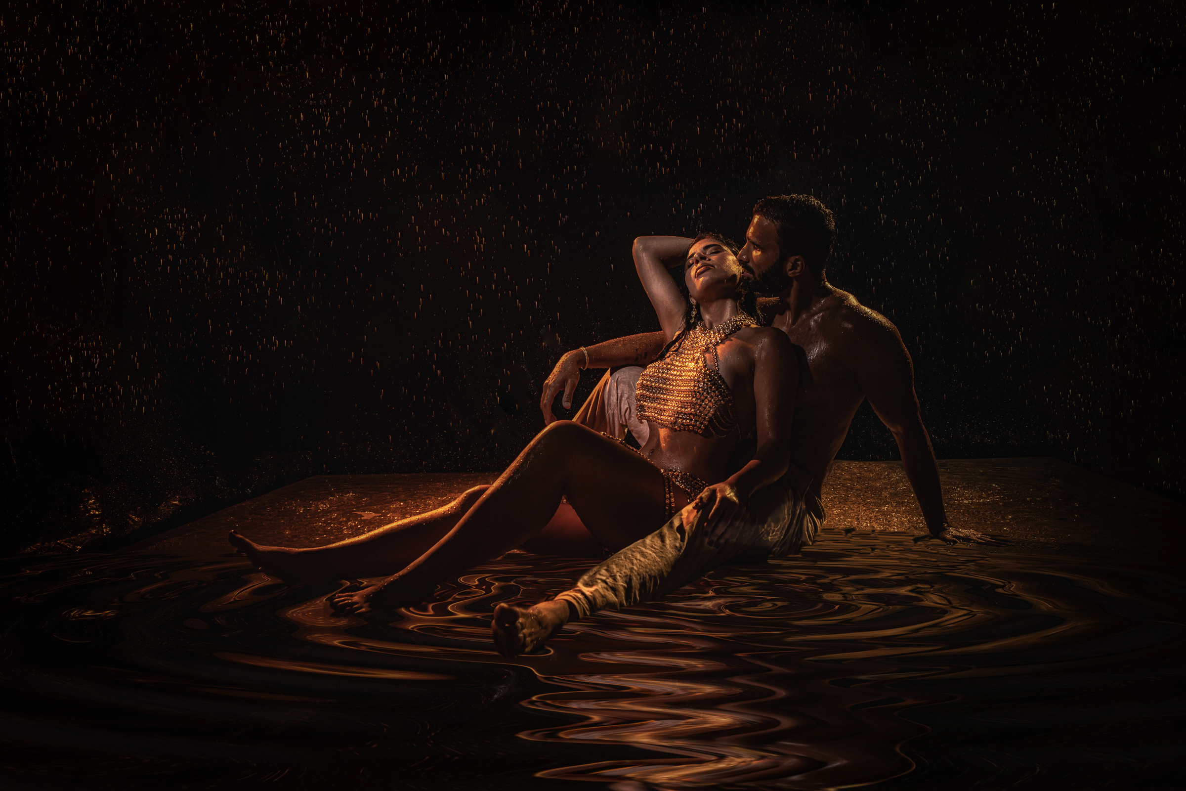 Couple in golden light on water - photo by Victoria Machin Photography