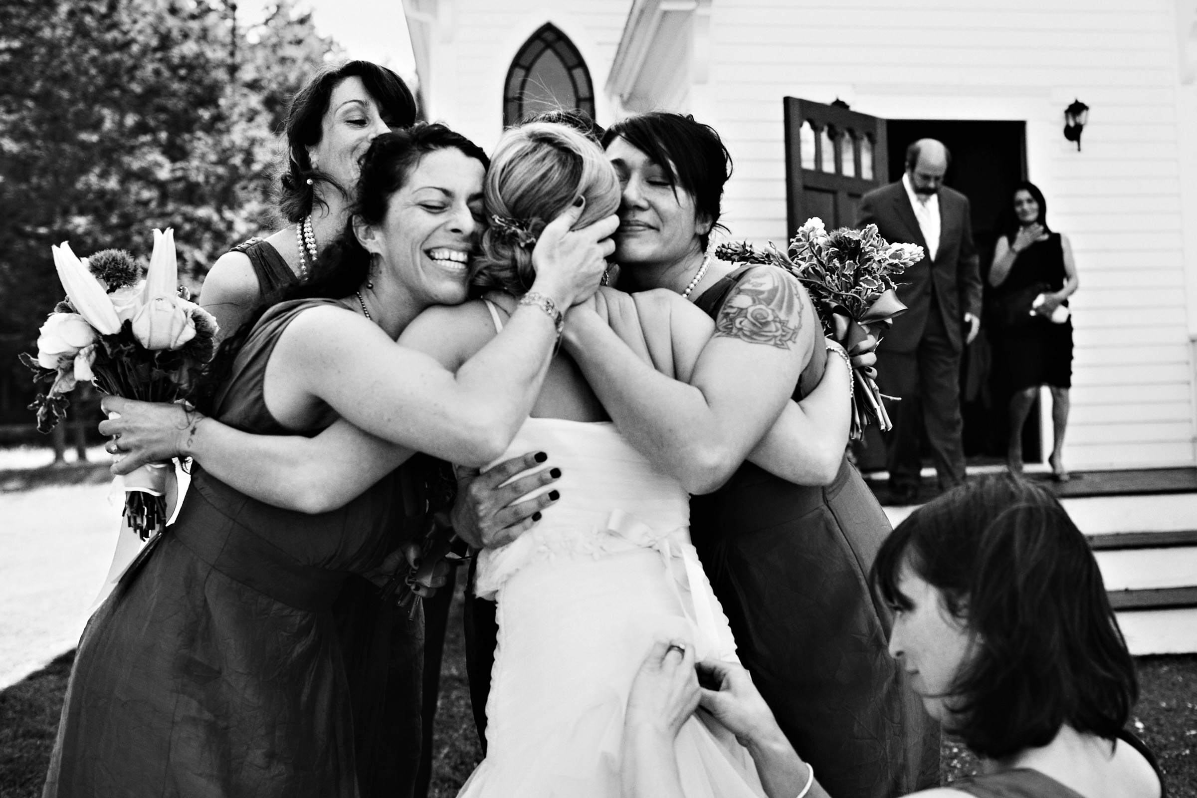 Bride and bridesmaids hugging - photo by Jenny Jimenez