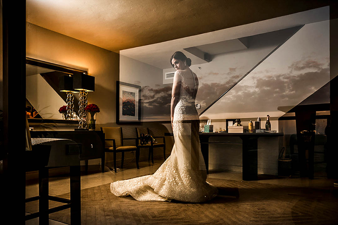 reflection of bride with clouds on the wall - photo by El Marco Rojo - Spain