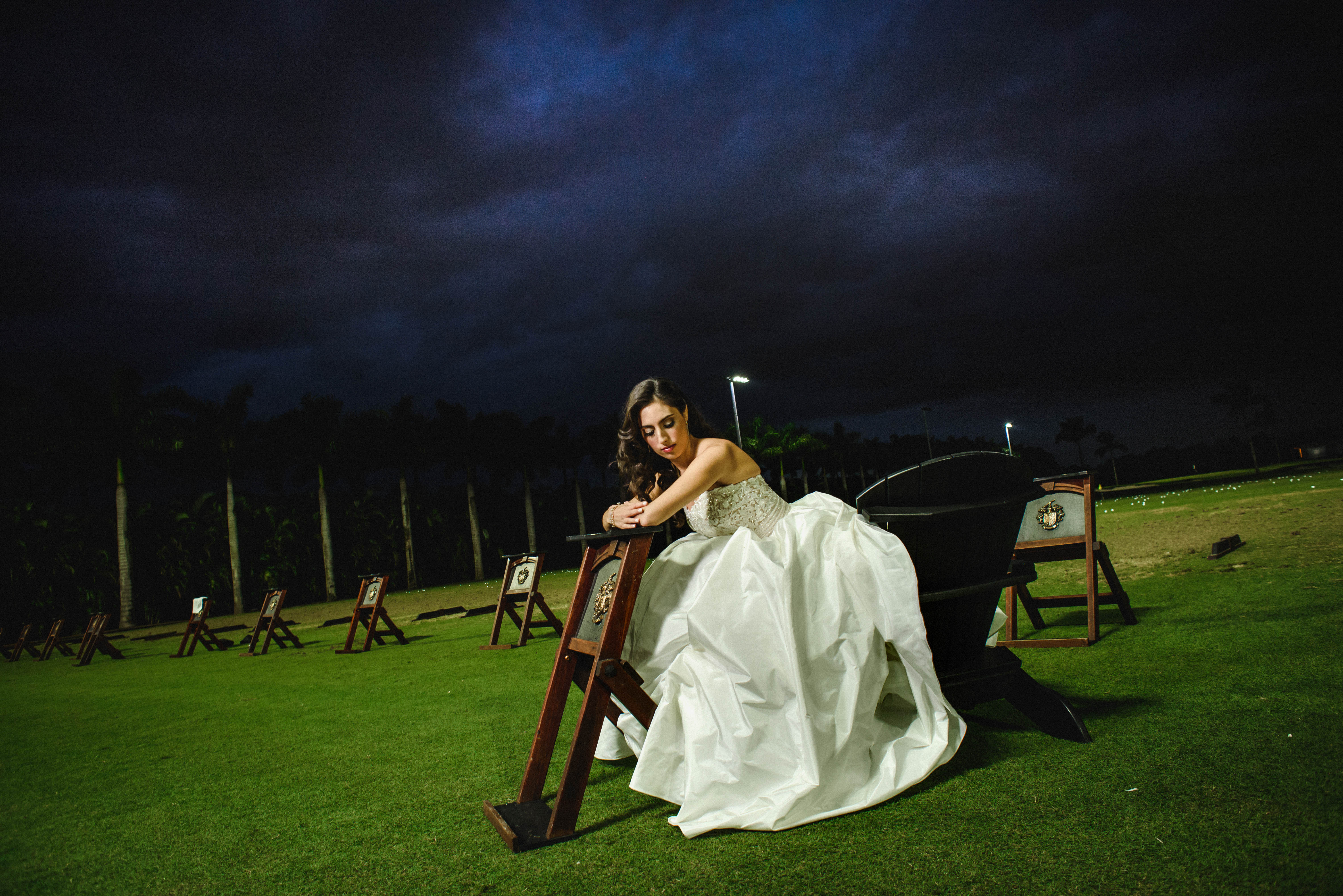 Seated bride under nighttime skies - photo by El Marco Rojo