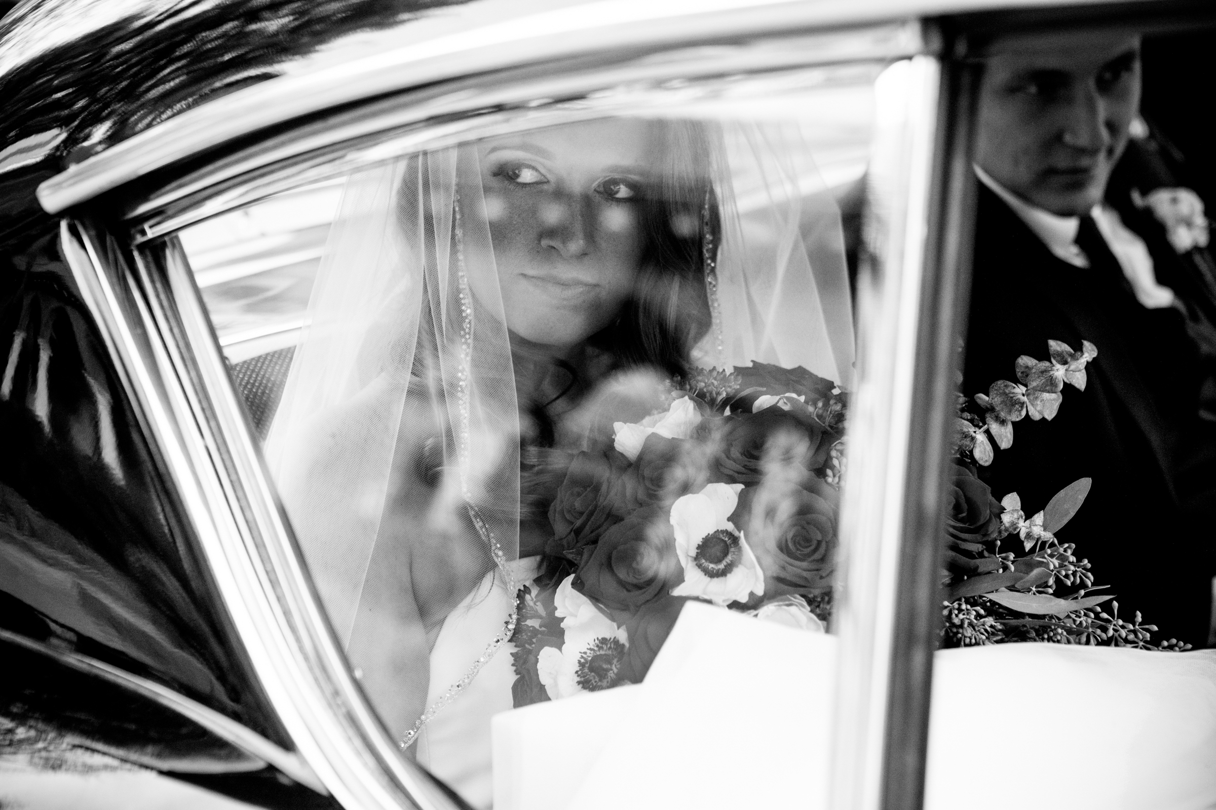 Bride in dappled light through limo window - photo by Jessica Hill Photography