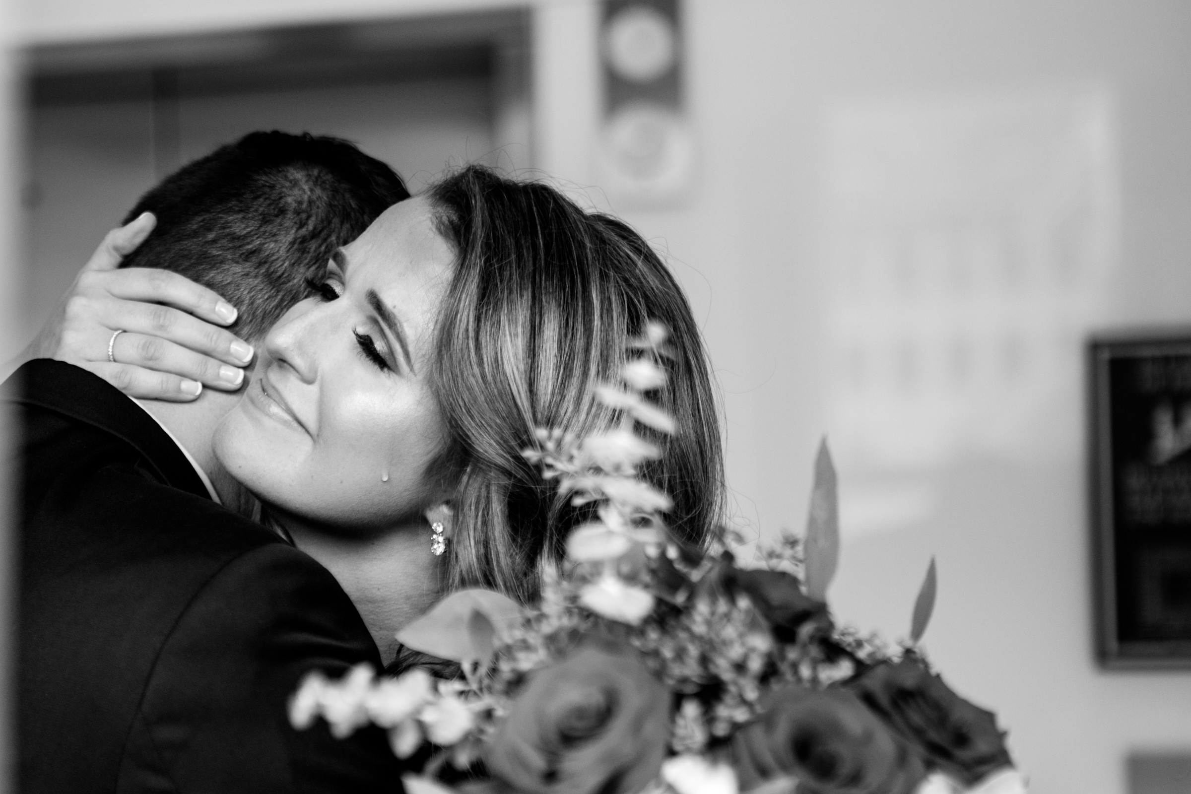 Couple embrace - photo by Jessica Hill Photography