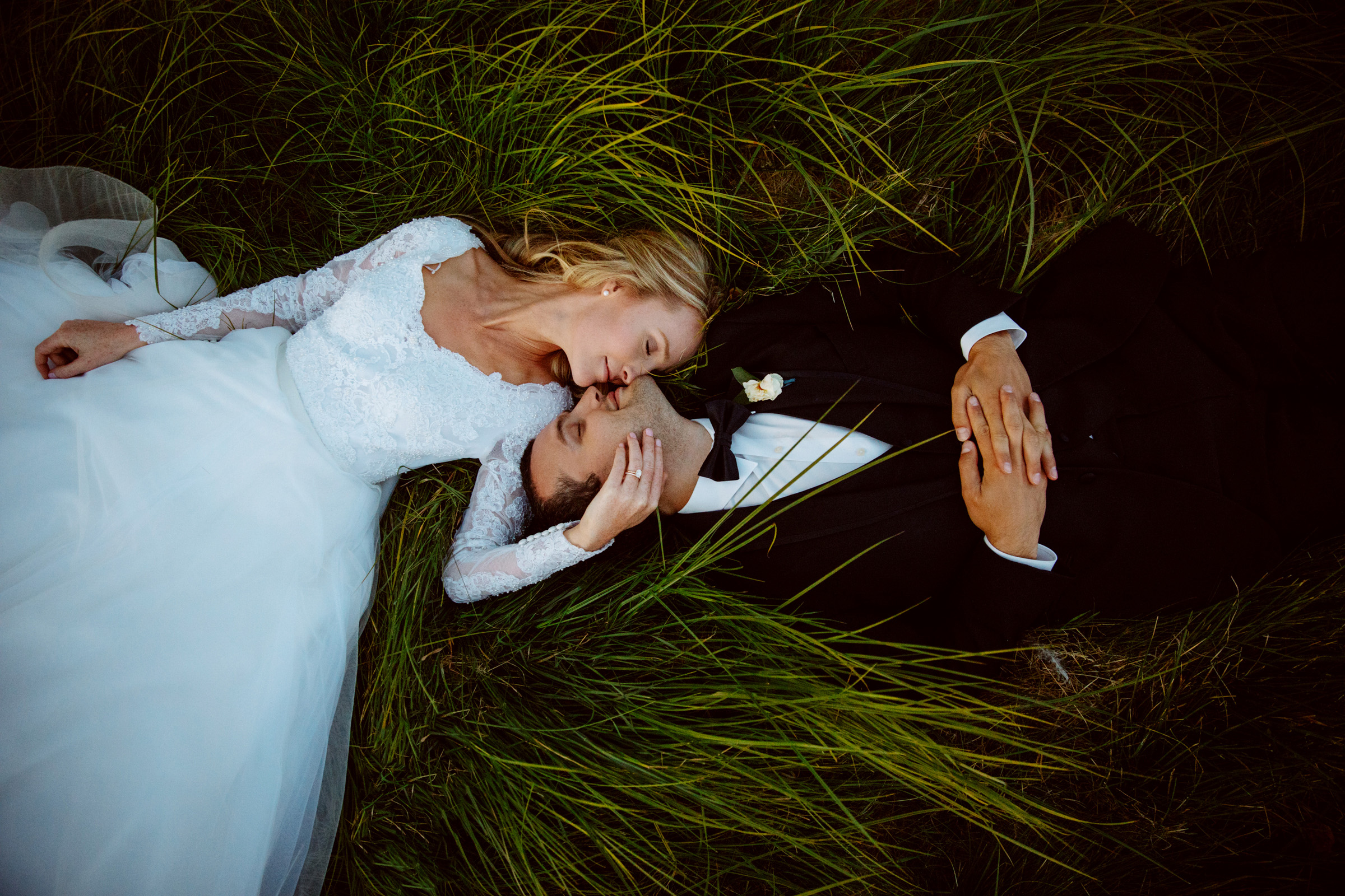 Couple portrait against grasses - photo by Jessica Hill Photography