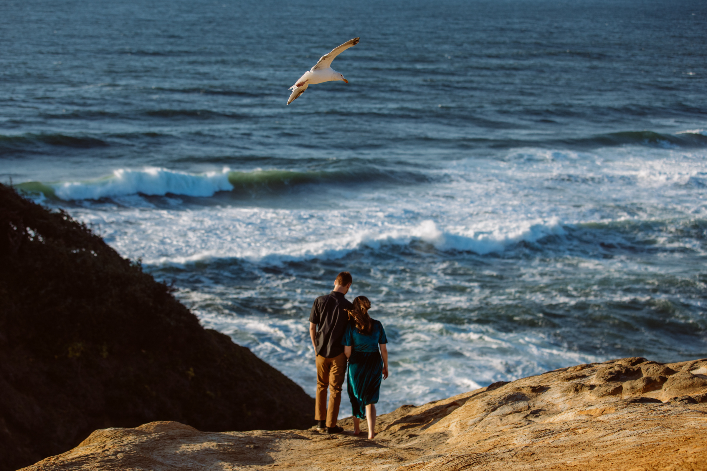 engagement couple above surf - photo by Jessica Hill Photography