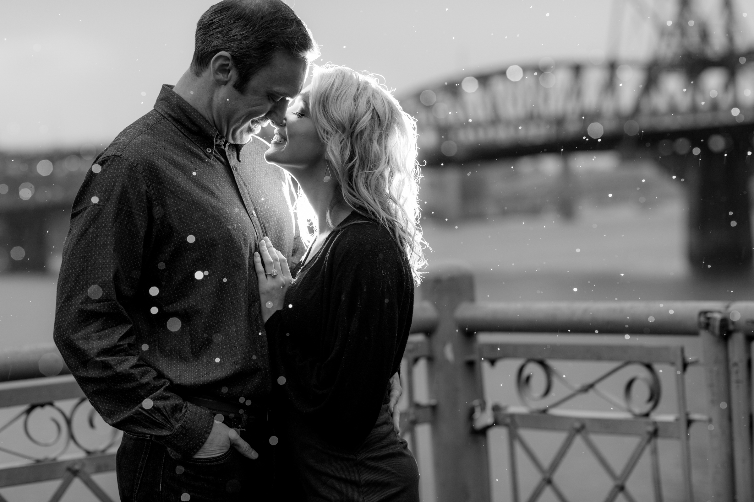 Sweet couple portrait against bridge - photo by Jessica Hill Photography
